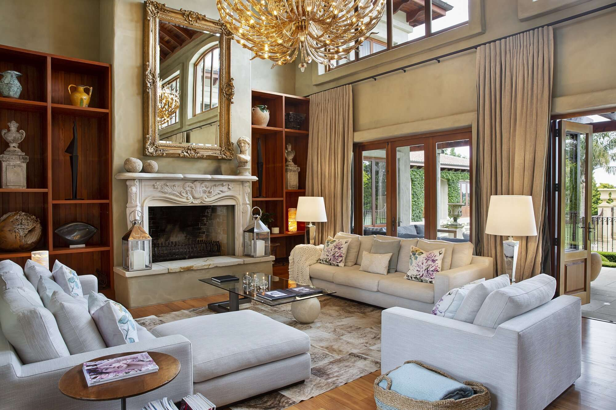 venetian decor in the lounge at Ataahua Lodge, with high ceilings and elegant chandelier