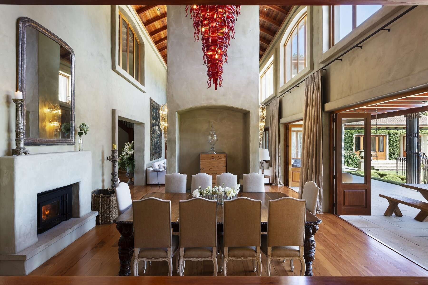 dining room with high ceilings and feature red ceiling light, at Ataahua Lodge one of the best villas in the world