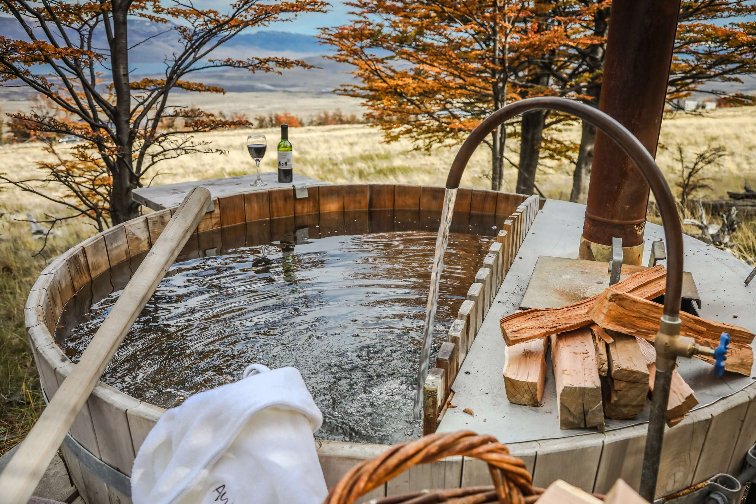 round wooden hot tub with mountain views at Awasi Patagonia, one of the most unique properties in the world