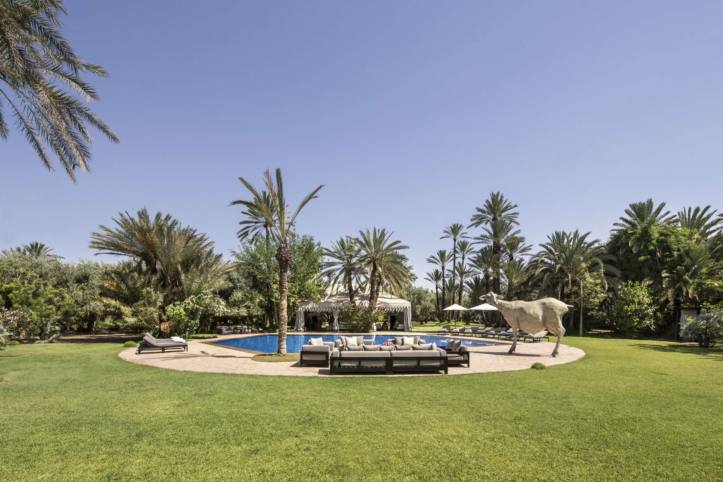 beautiful garden and pool at the house designed by French contemporary artist Jean-François Fourtou