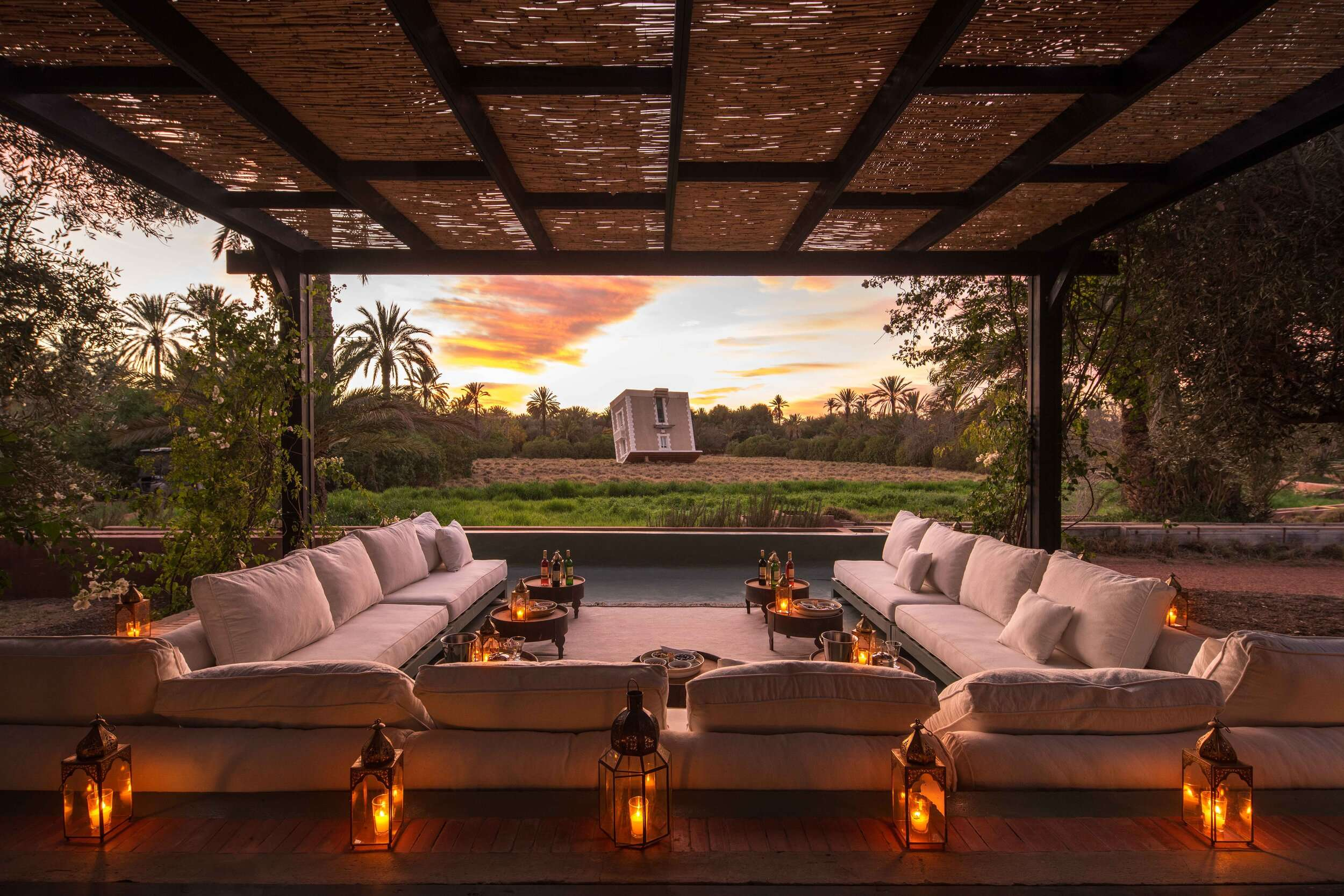 view from Dar el Sadaka outside lounge at sunset, an upside down house in the distance