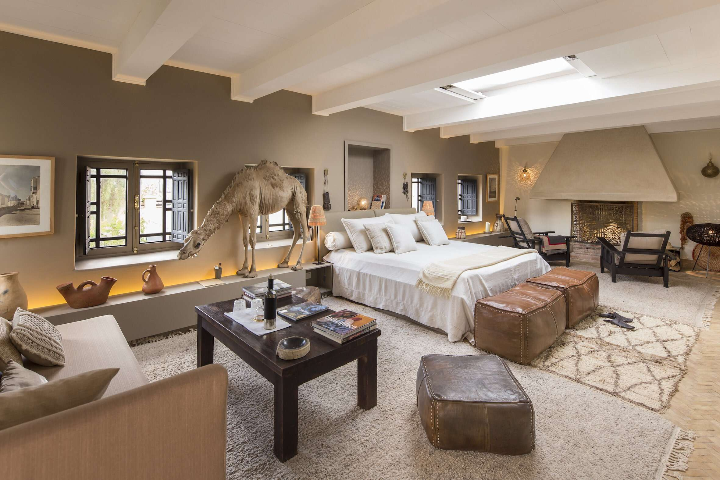 bedroom suite at Dar el Sadaka in Marrakech, with large camel figure by the window