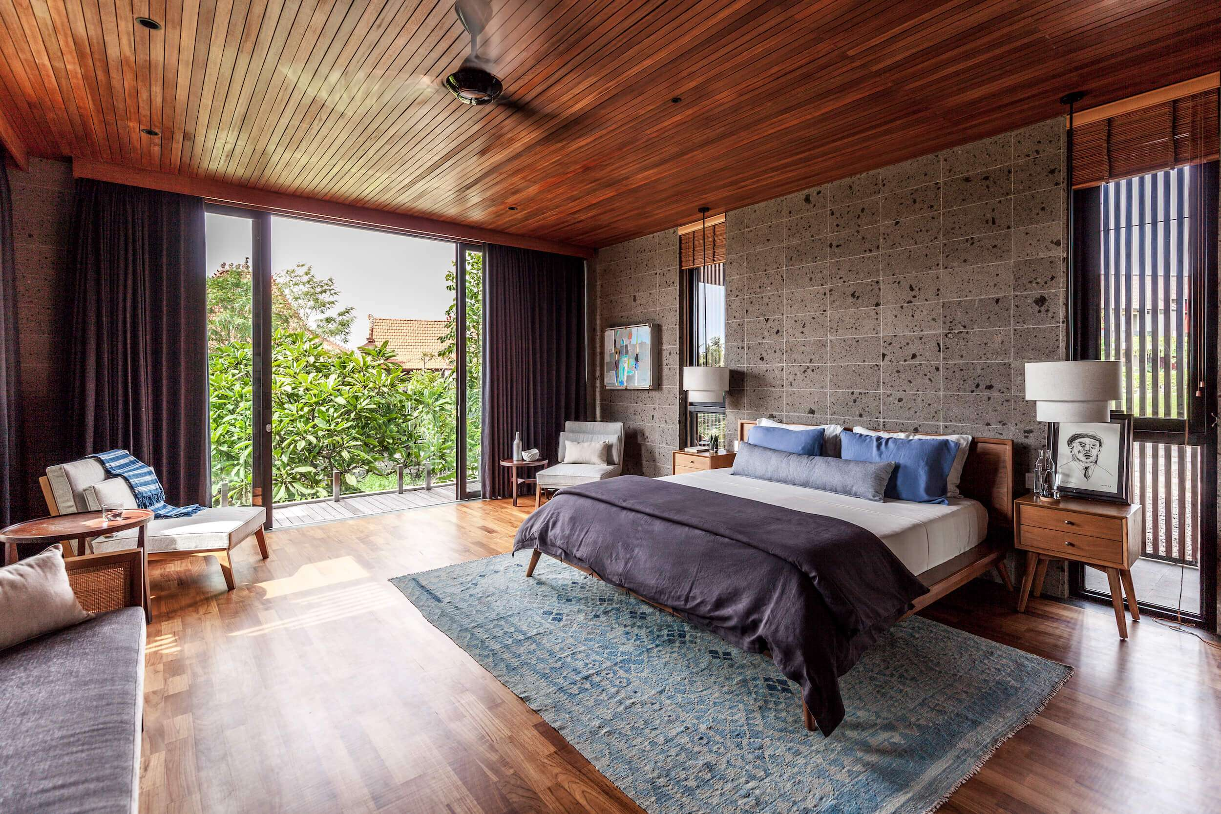 large bedroom with wooden ceiling at Riverhouse Bali, one of the best villas in the world