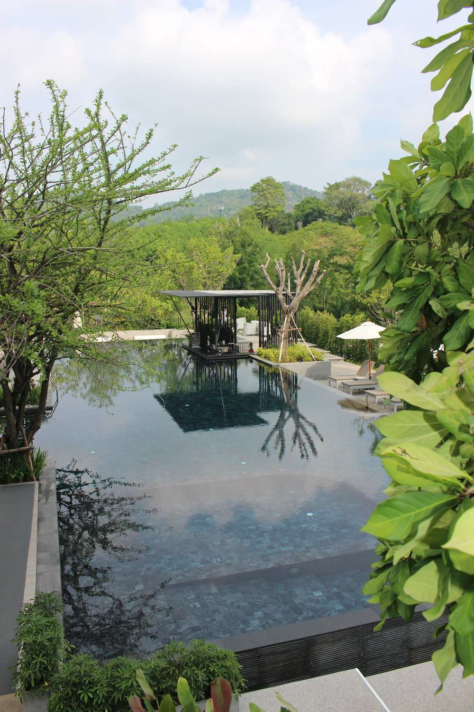 swimming pool with swim up bar set in lush greenery at Anana Ecological Resort, Krabi, Thailand
