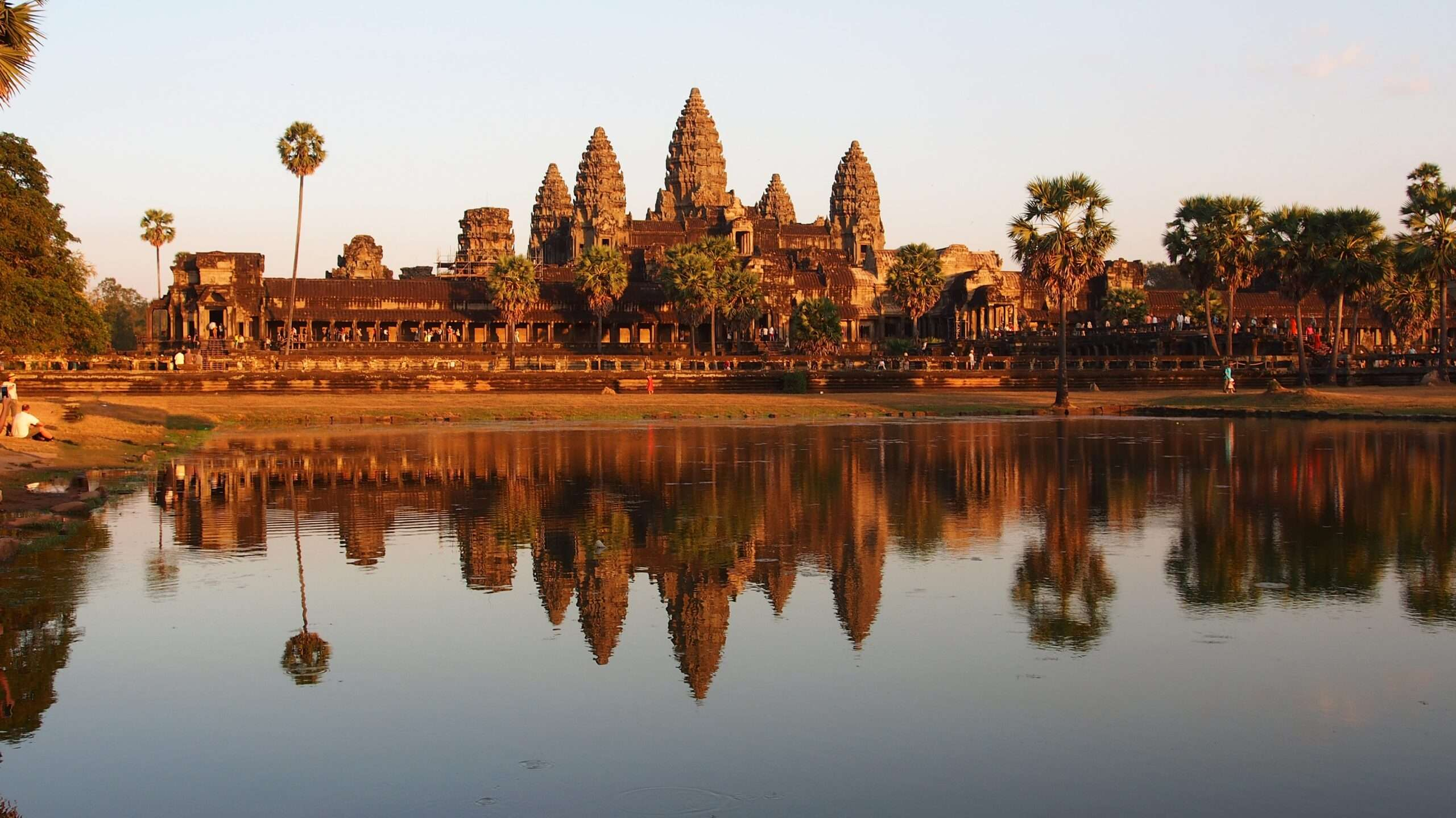 Angkor Wat Buddhist Temples in Cambodia, seen from across the water at sunrise
