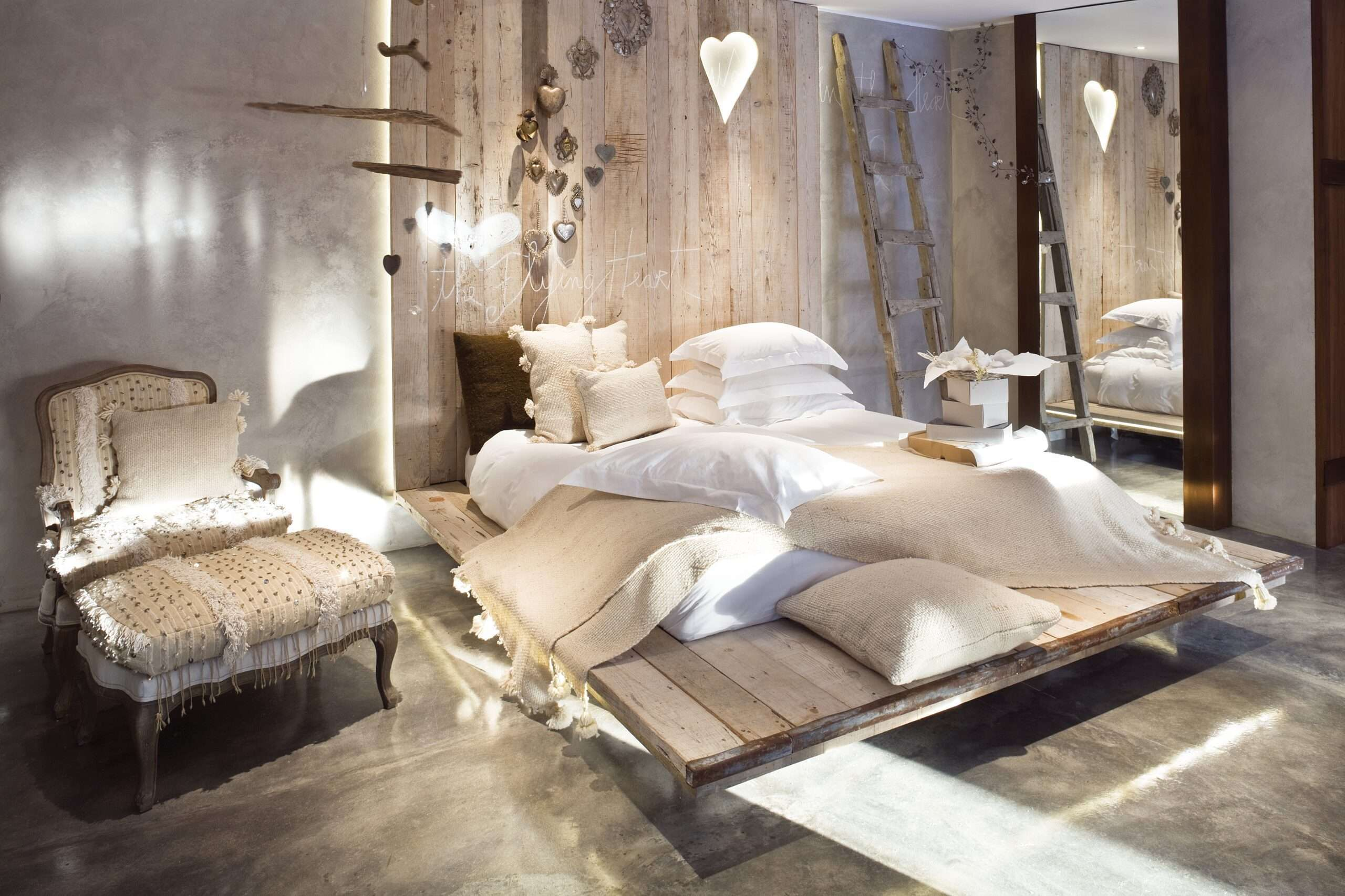 Bedroom decorated with neutral coloured wood and natural materials at Areias do Seixo Luxury Eco Retreat