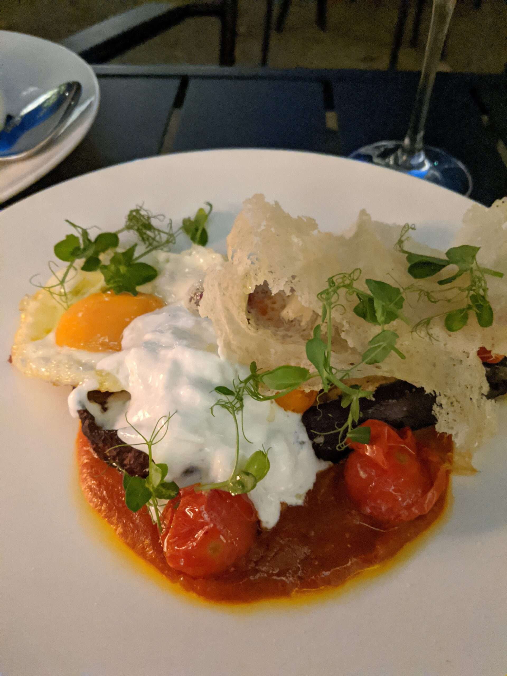 main course at Kazerne, of the the best places to eat in Eindhoven, with tomato sauce, aubergine parmigiana, and delicately fried cheese