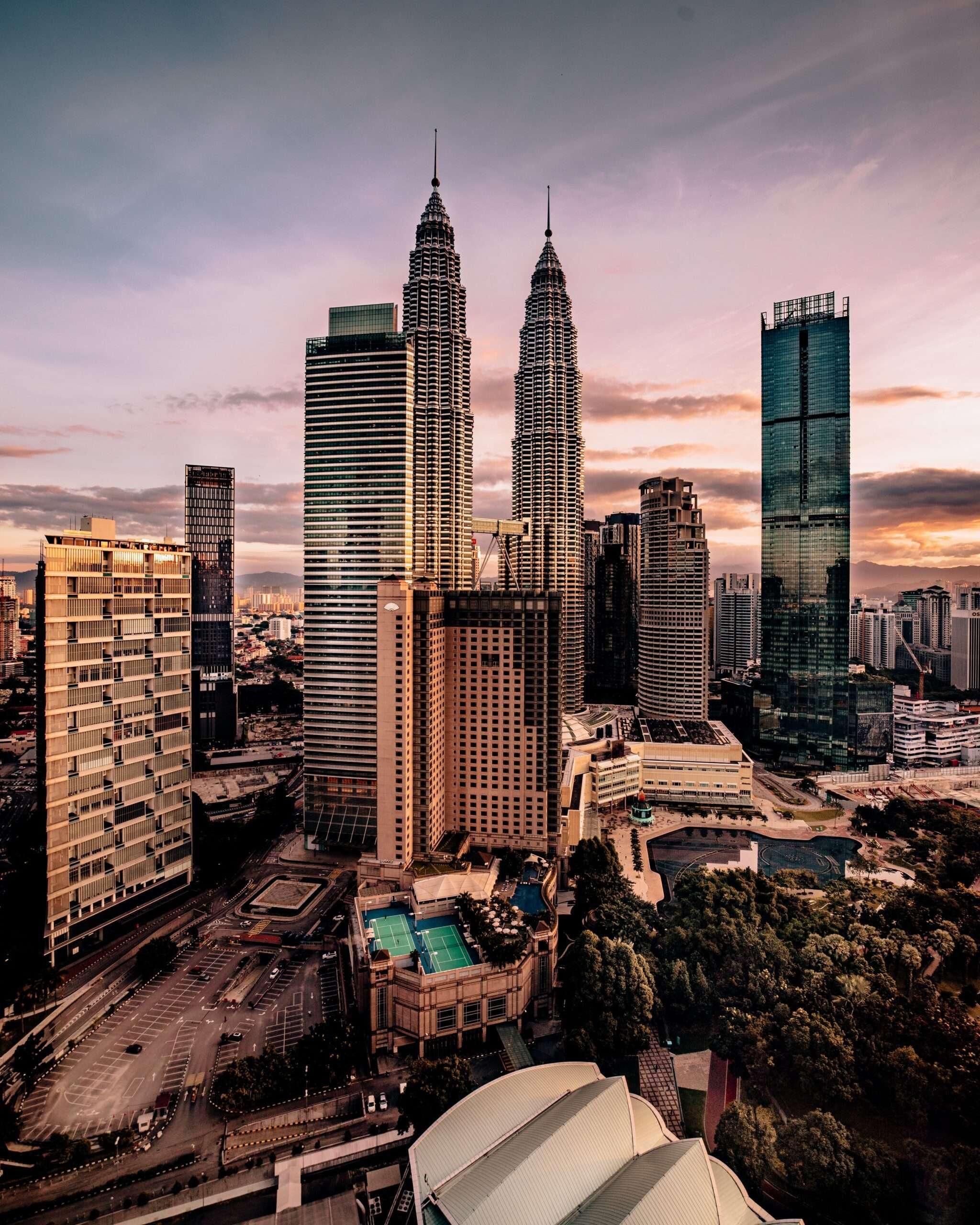 Kuala Lumpur skyline with Petronas Towers at sunset