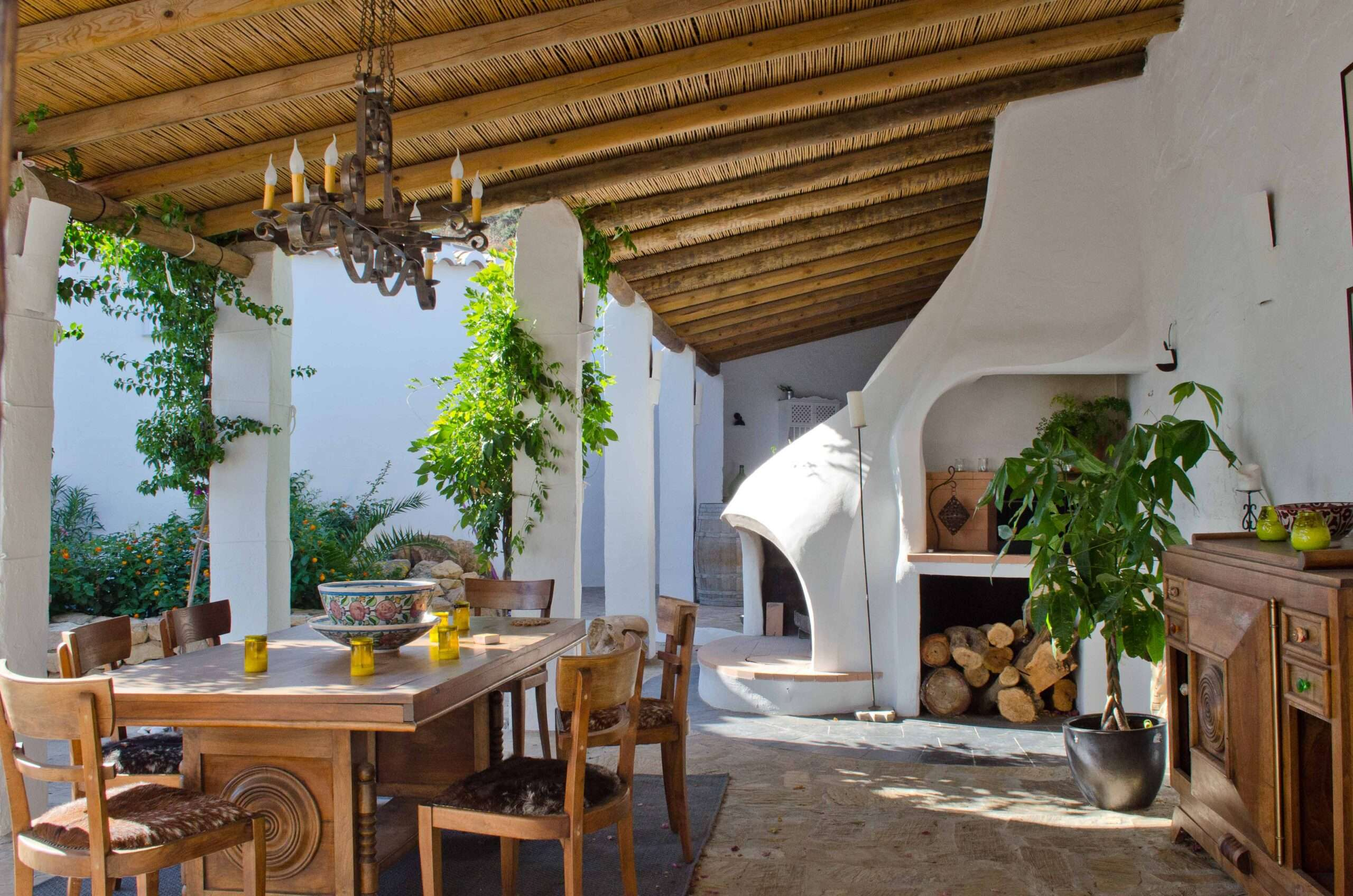 Open air kitchen and dining room at Villa El Carligto in Spain