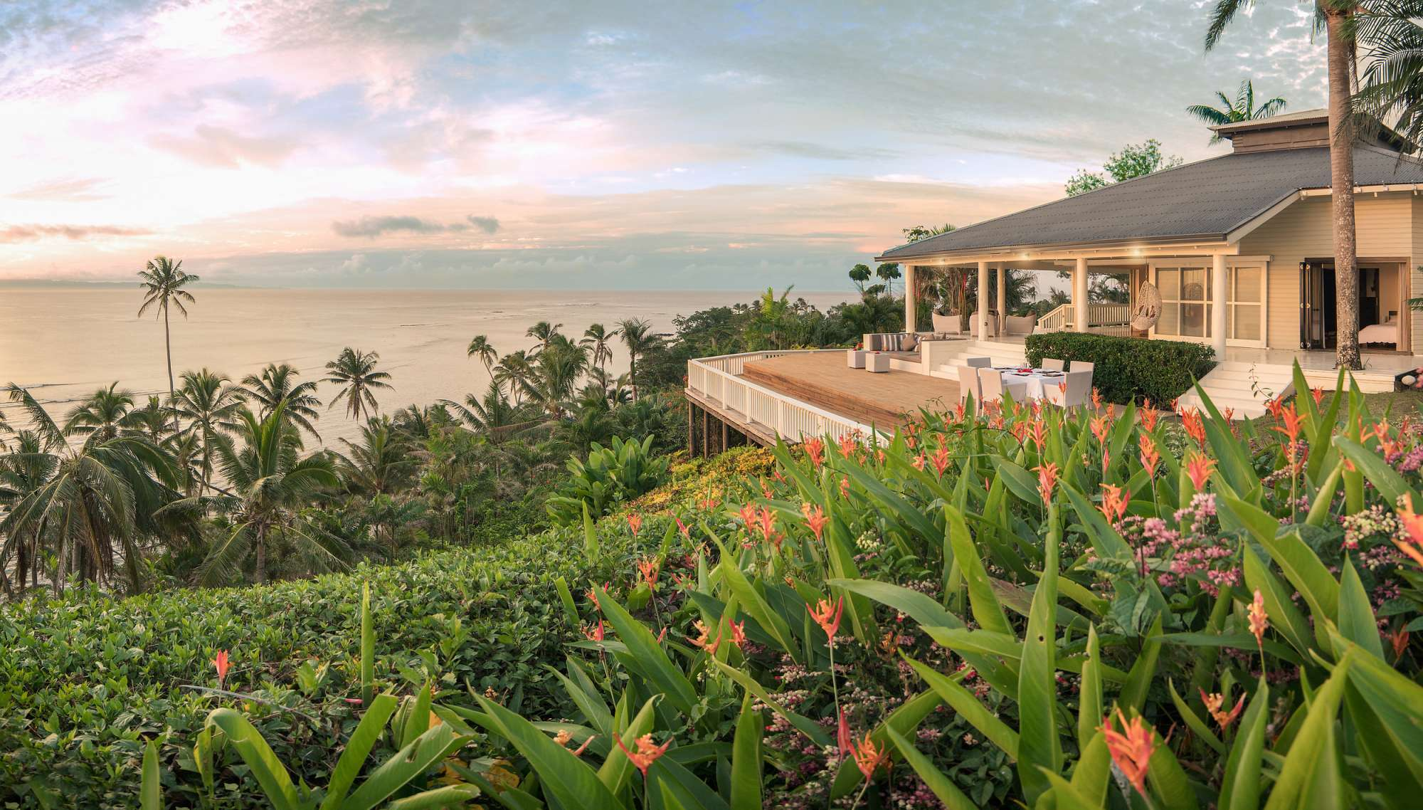 Raiwasa Resort Fiji at sunset with ocean view