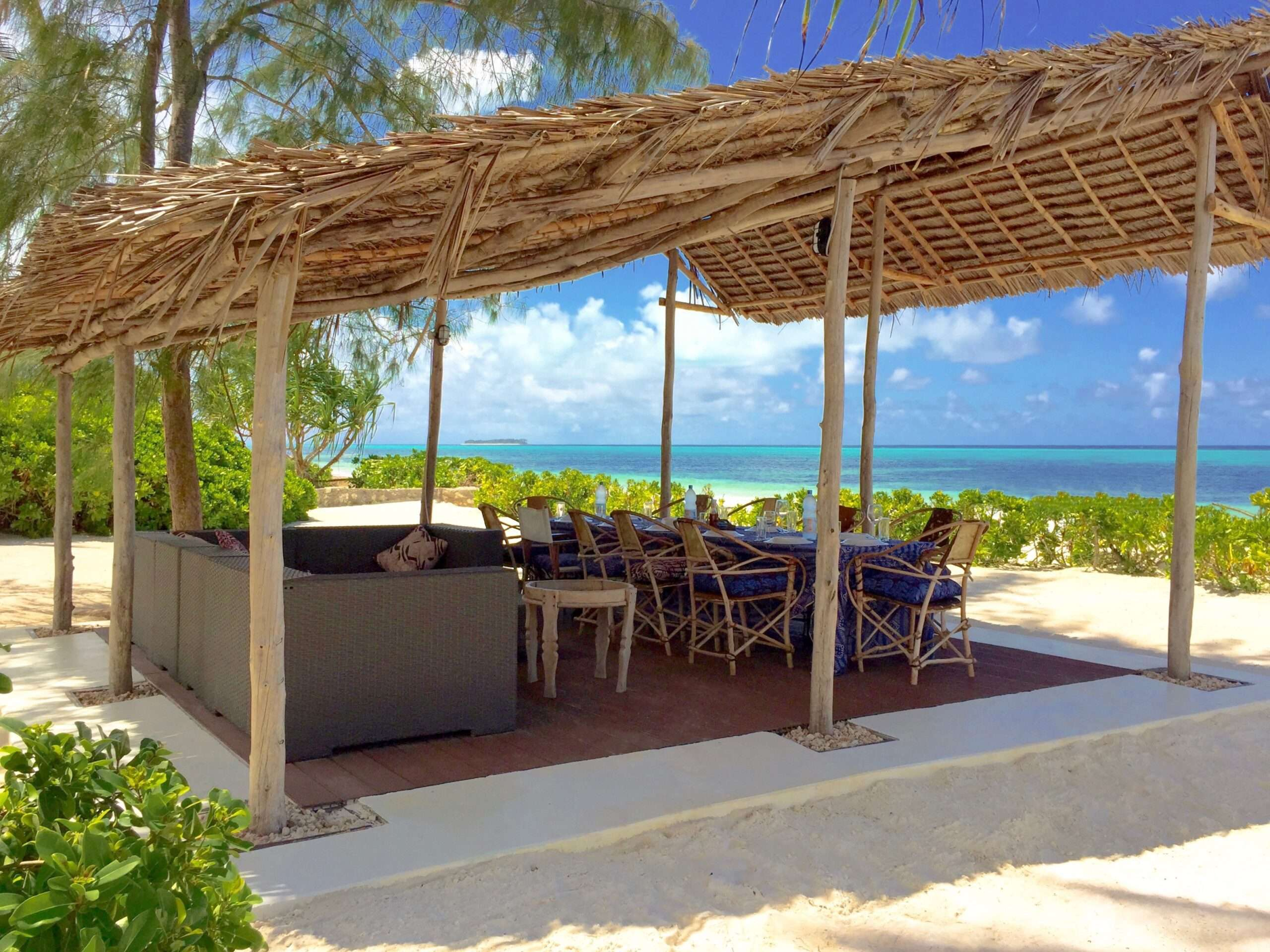 seating area and dining table on the beach at Turquoise Beach Villa Zanzibar