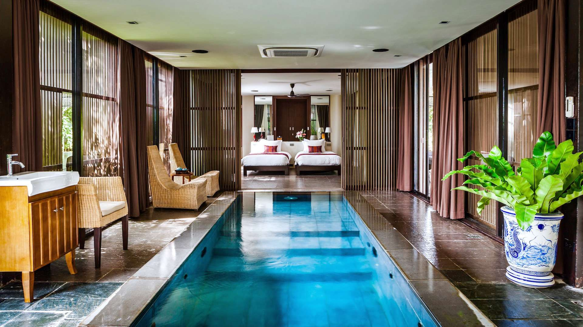 indoor swimming pool leading to bedroom at Villa Akatsuki Koh Samui