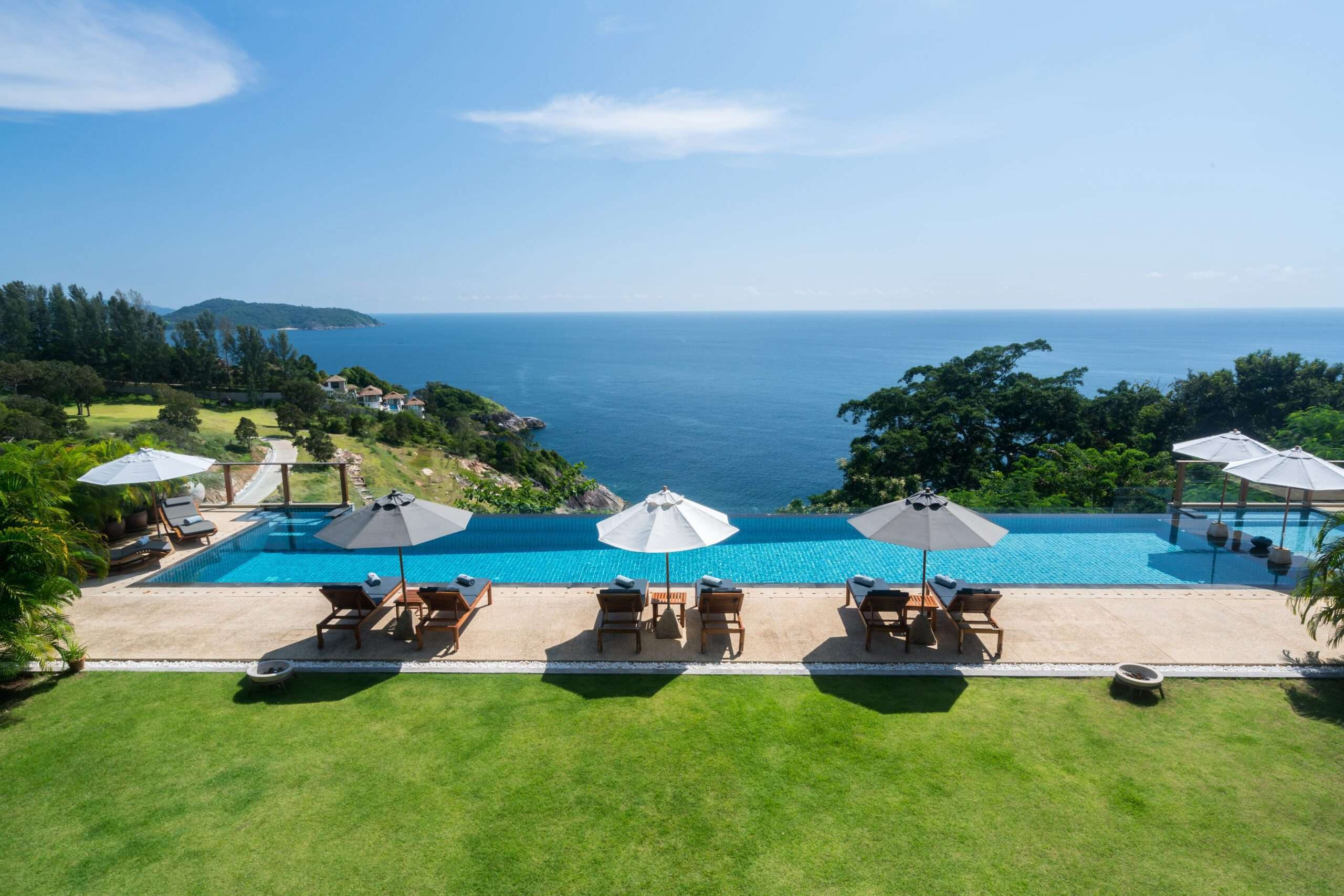 Lawn and swimming pool at Villa Aye in Phuket, Thailand