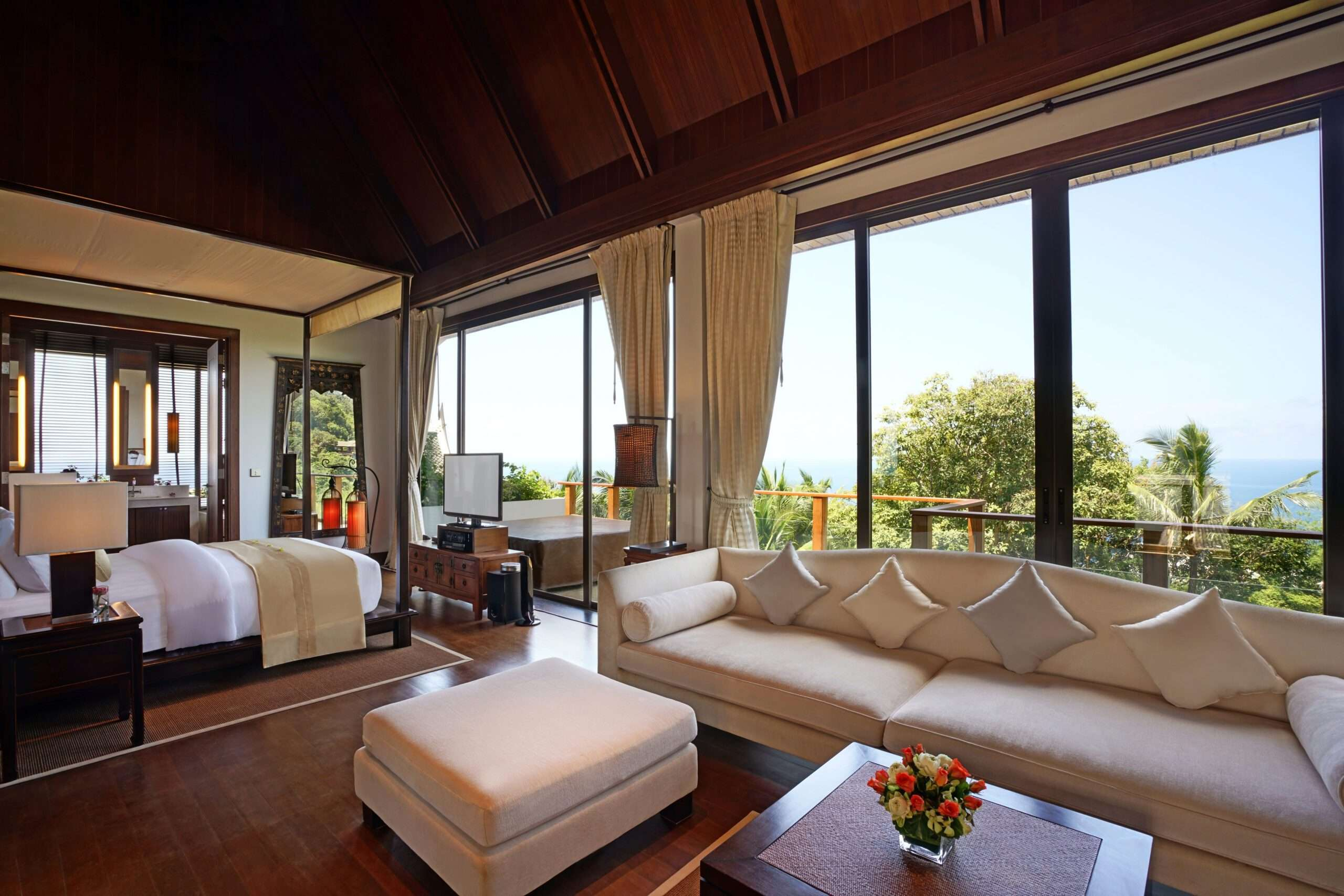 Master bedroom with bed and sofa at Infinity pool at Villa Aye in Phuket, Thailand