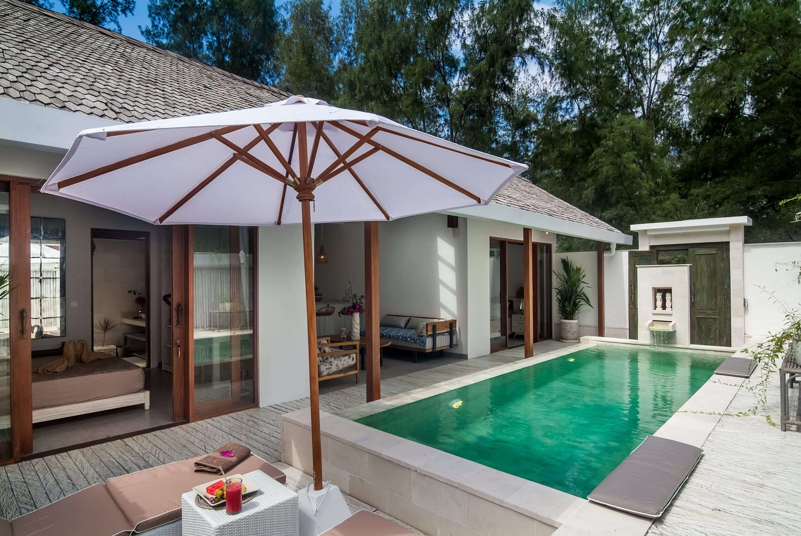 bedrooms open out to the pool at Villa Coral Flora in Gili Trawangan