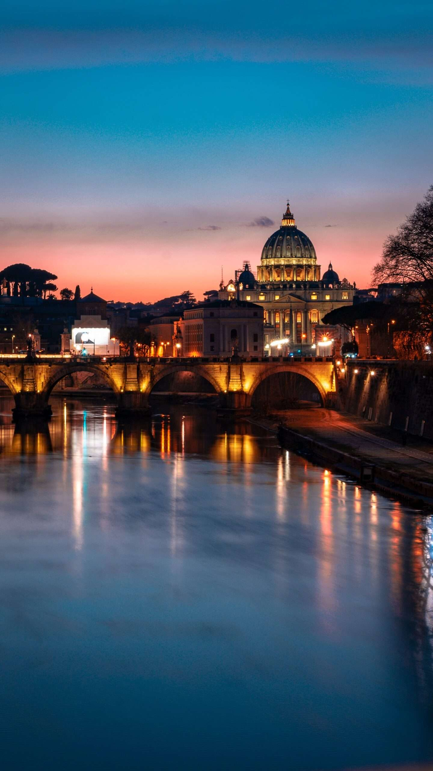Tiber river at night in Rome with St.Peter's basilica in the background