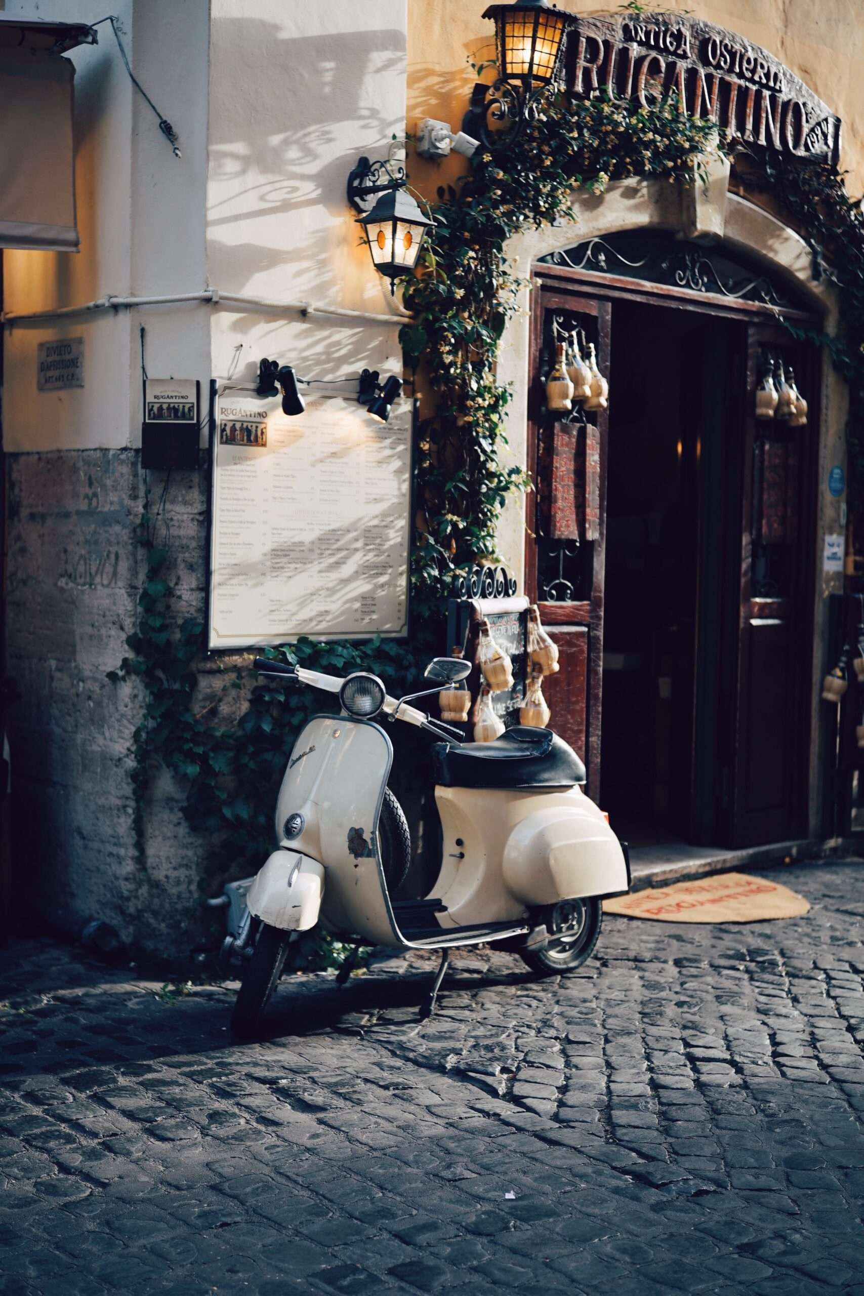 Vespa parked in old Rome neighbourhood Trastevere