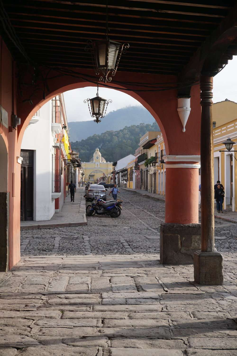 under an archway in Antigua, Guatemala,