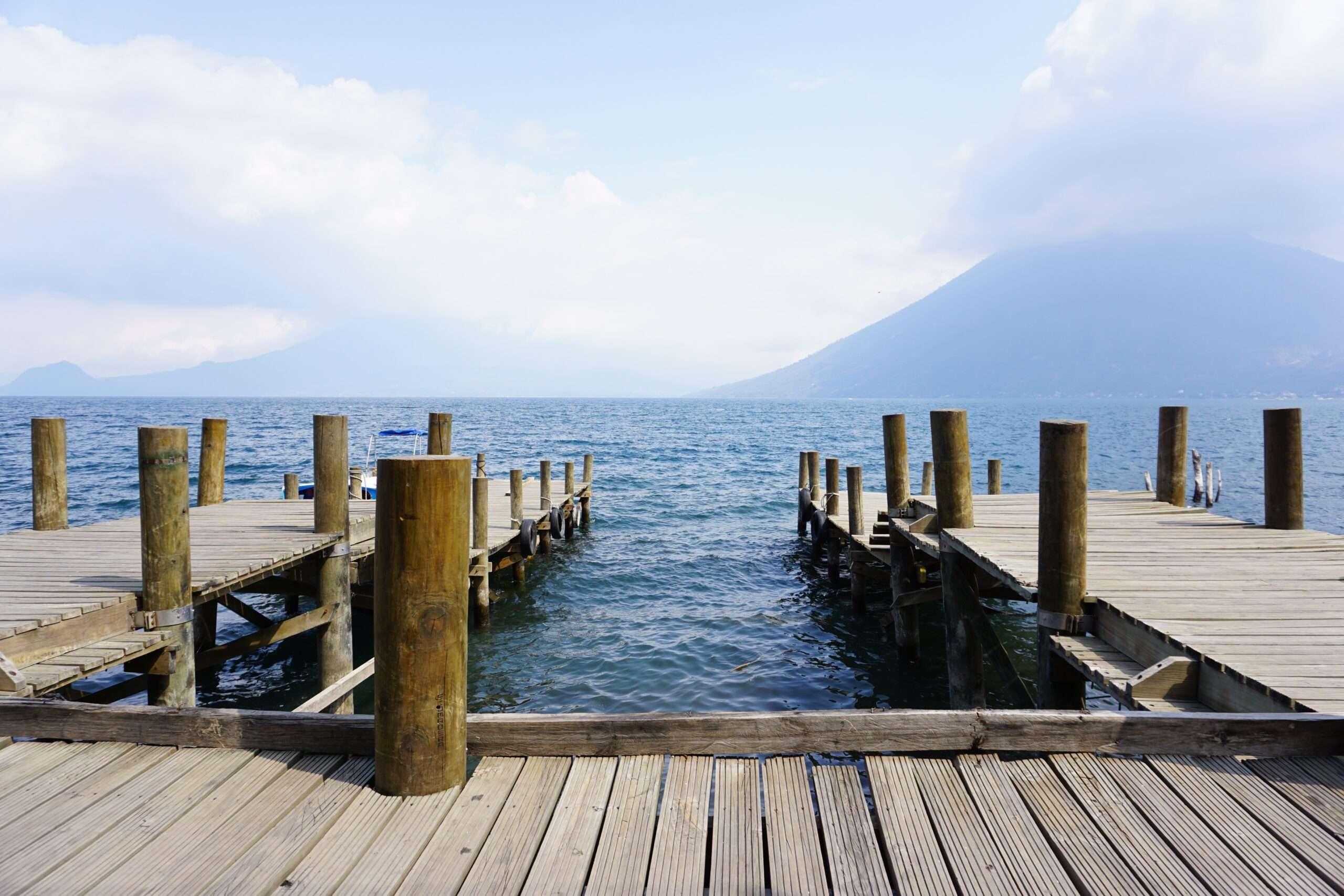 a U-shaped wooden deck at the edge of Lake Atitlan