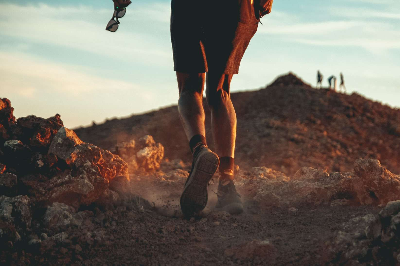hiker walks on dry dirt at sunrise, a great activity for Galápagos island travel