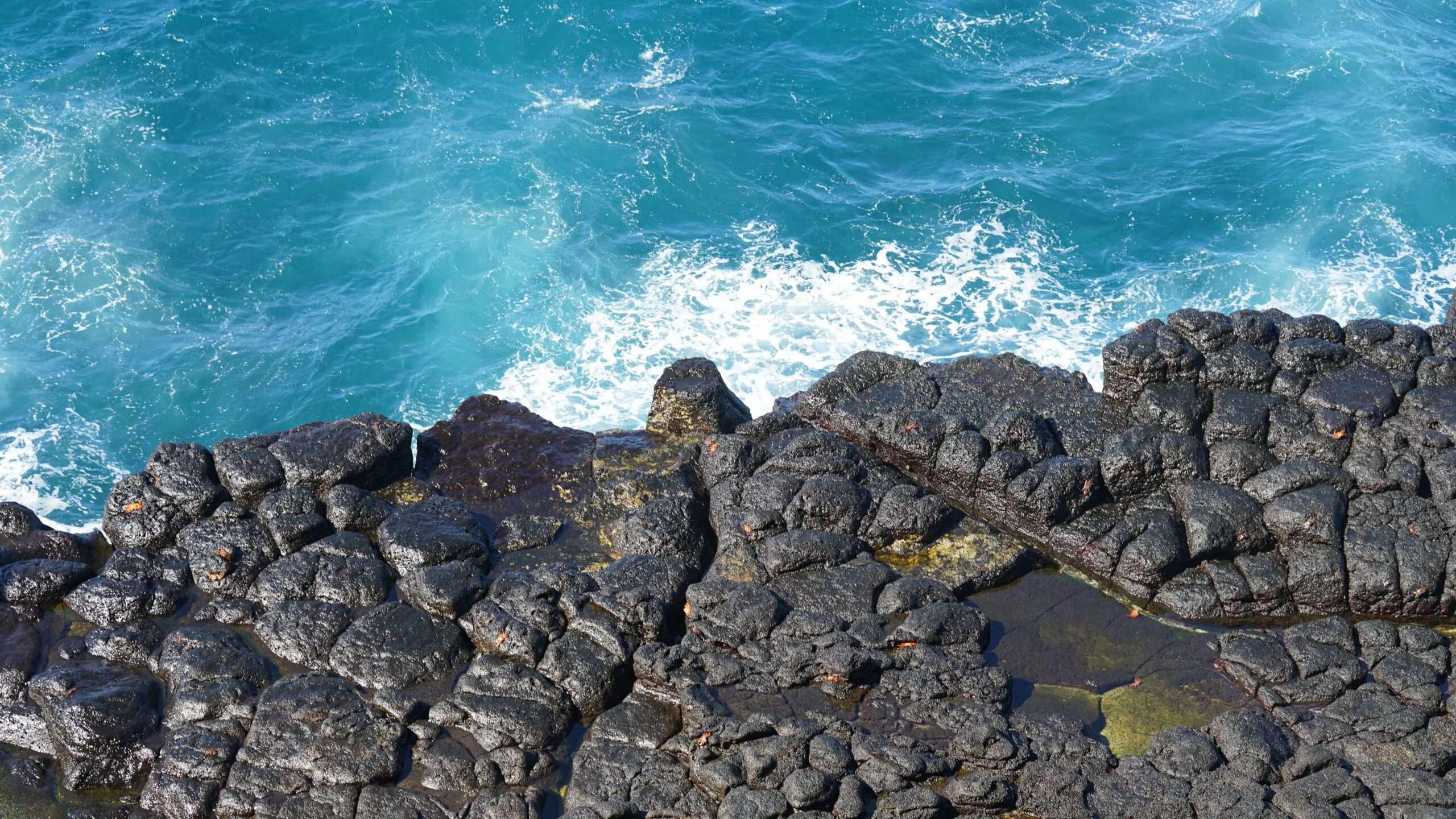 waves crash against the rocks in Galápagos islands