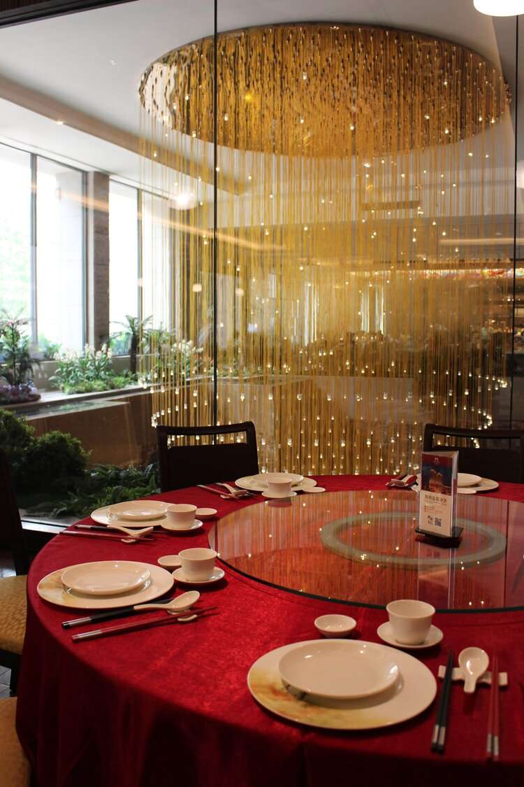 red circular table set for dinner in a restaurant at Grand Mayfull Hotel Taipei