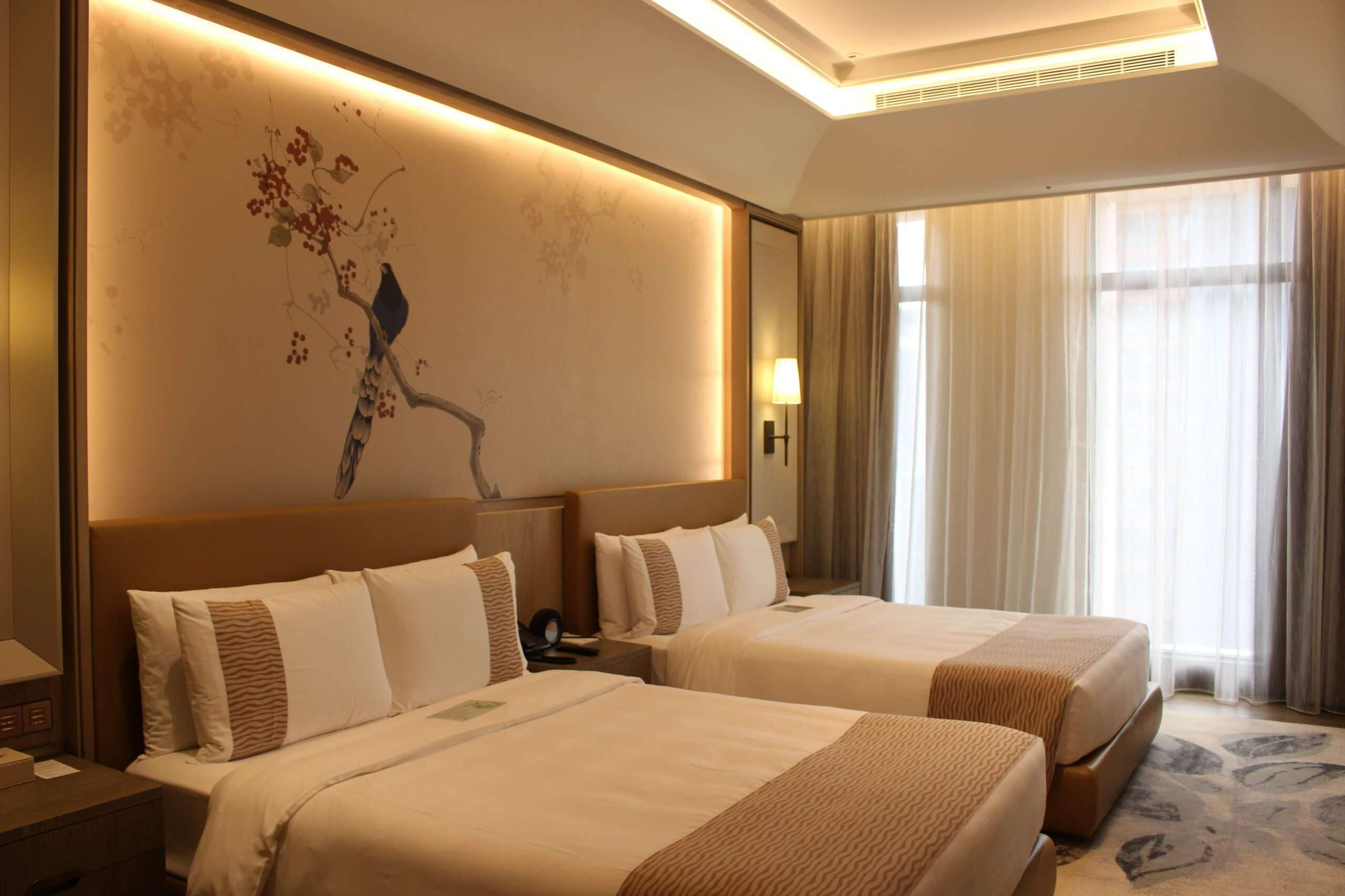 two double beds in a neutral coloured room at Grand Mayfull Hotel, Taipei