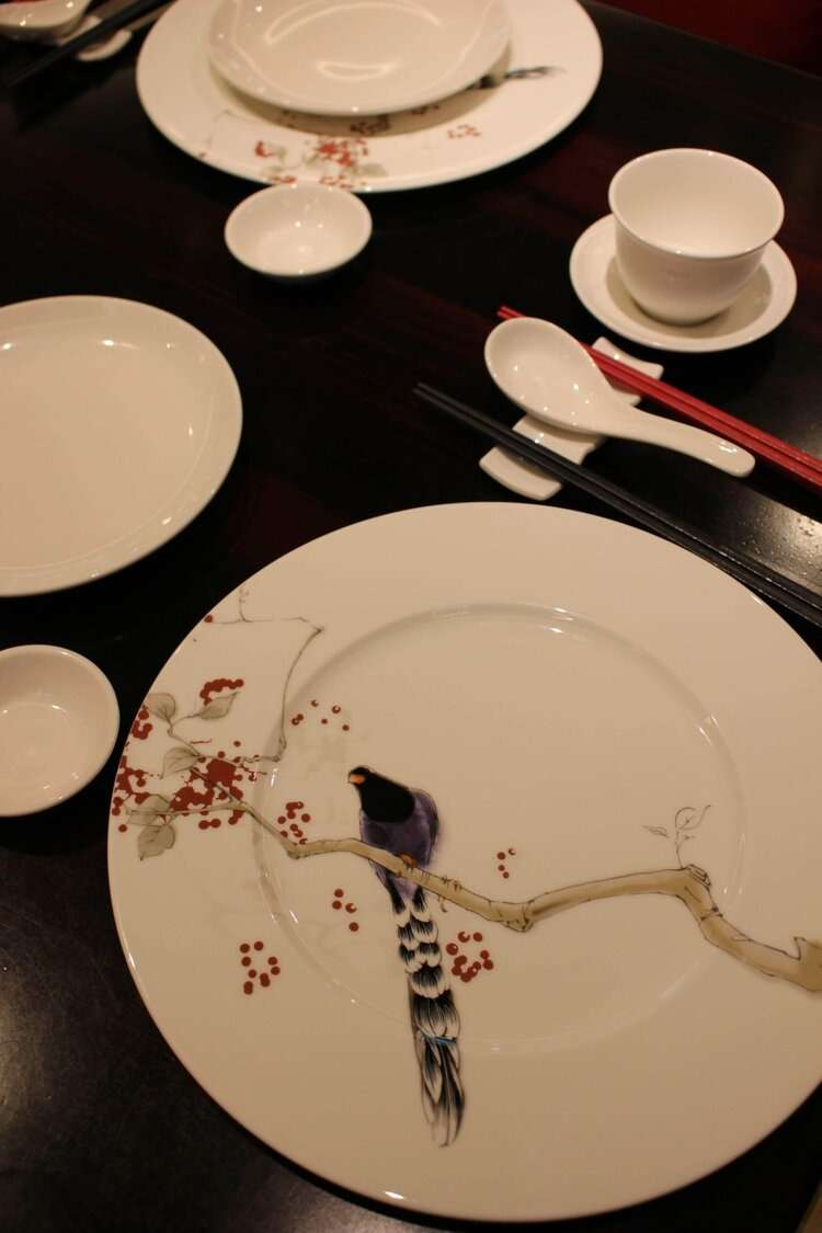 dinner set decorated with hand painted bird in a restaurant at Grand Mayfull Hotel Taipei
