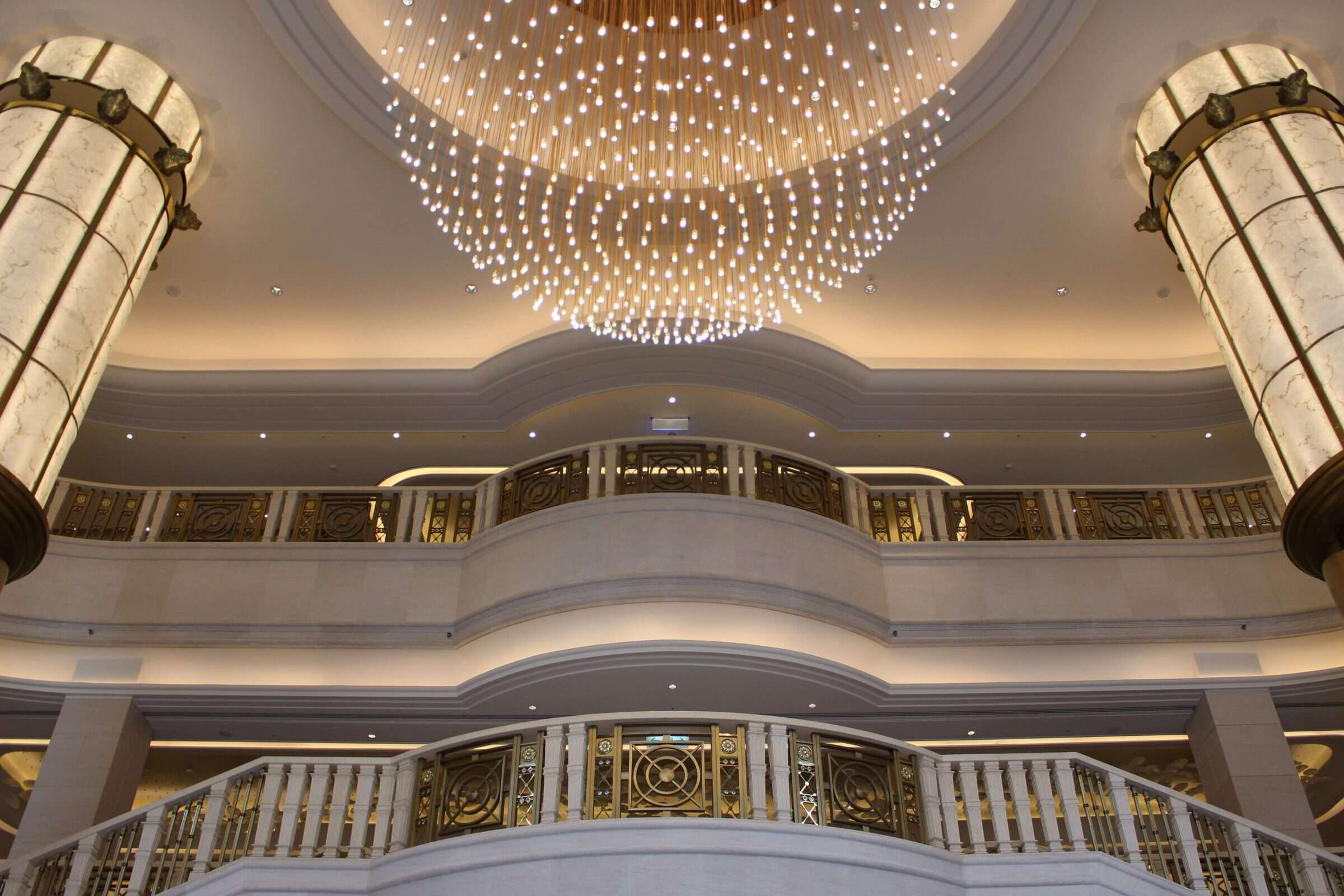 large chandelier hangs in the foyer of Grand Mayfull Hotel in Taipei