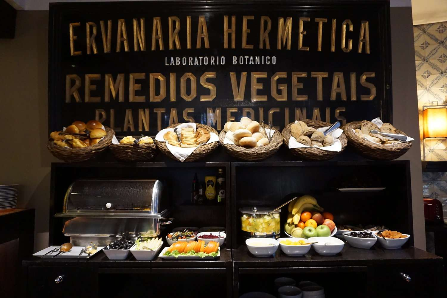 Heritage Avenida Liberdade breakfast buffet with breads, fruit, cheese and meats