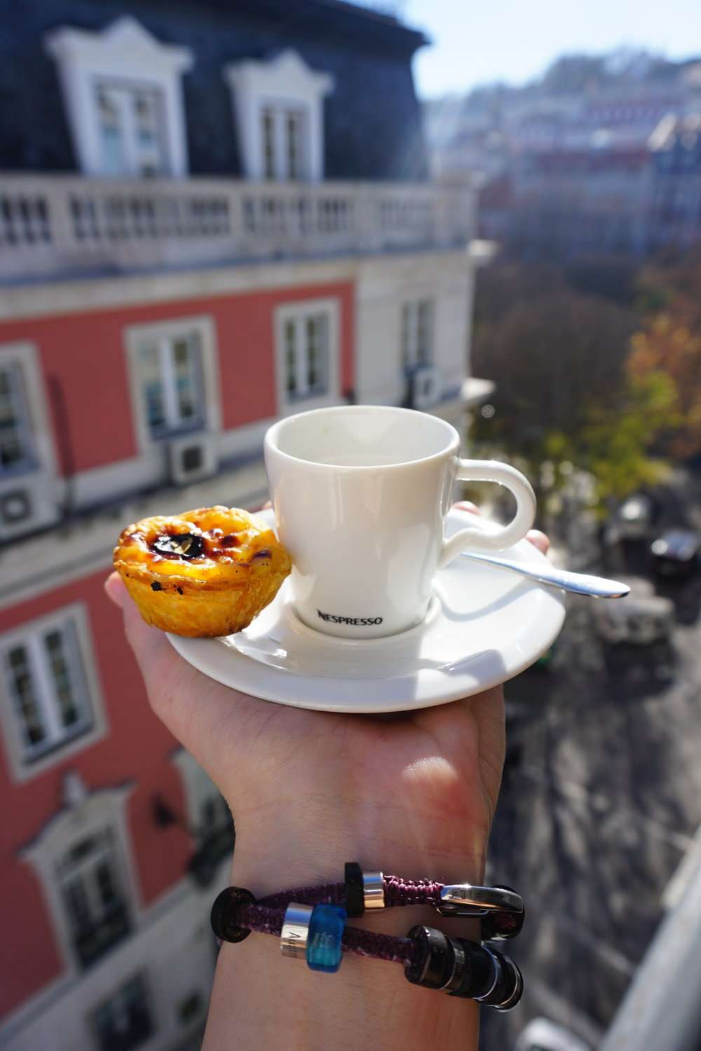 cup of coffee and a pastel de nata in lisbon