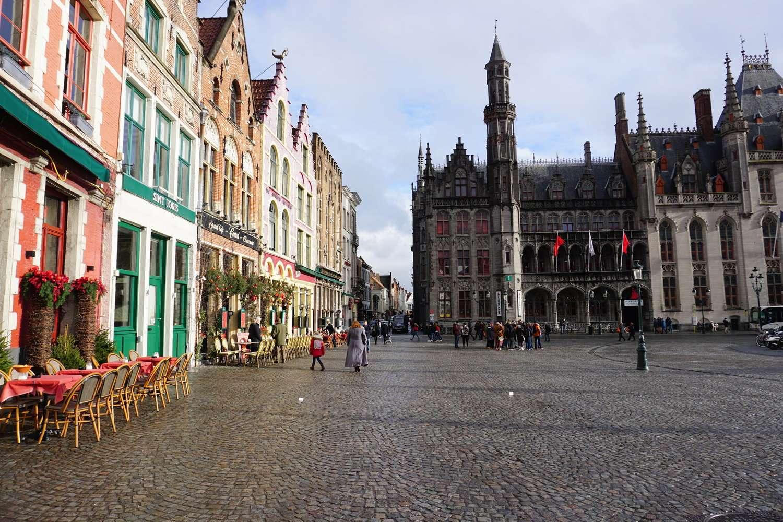Tourists explore the Markt in Bruges