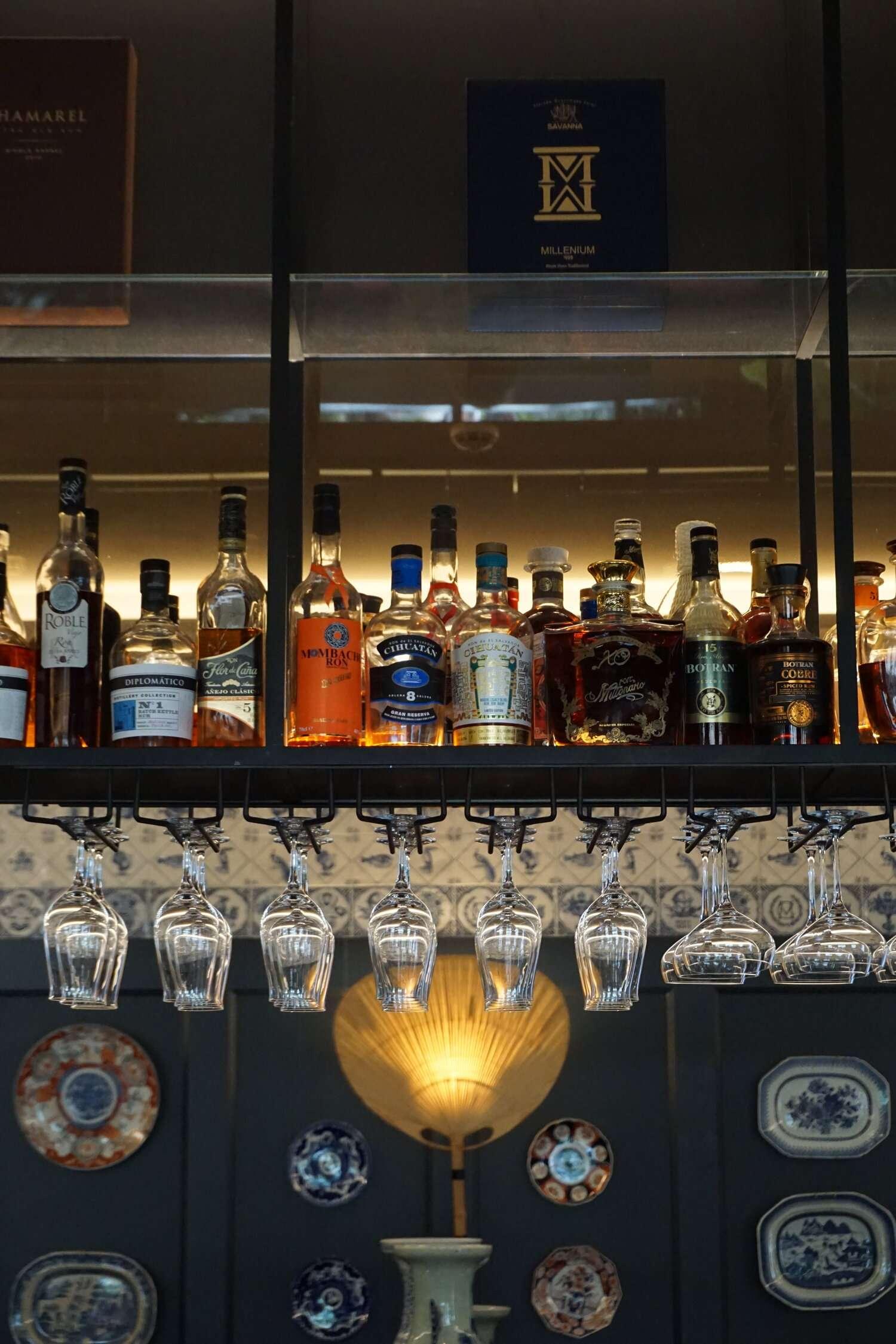 bottles of spirits in the bar at Hotel Monte Cristo Paris