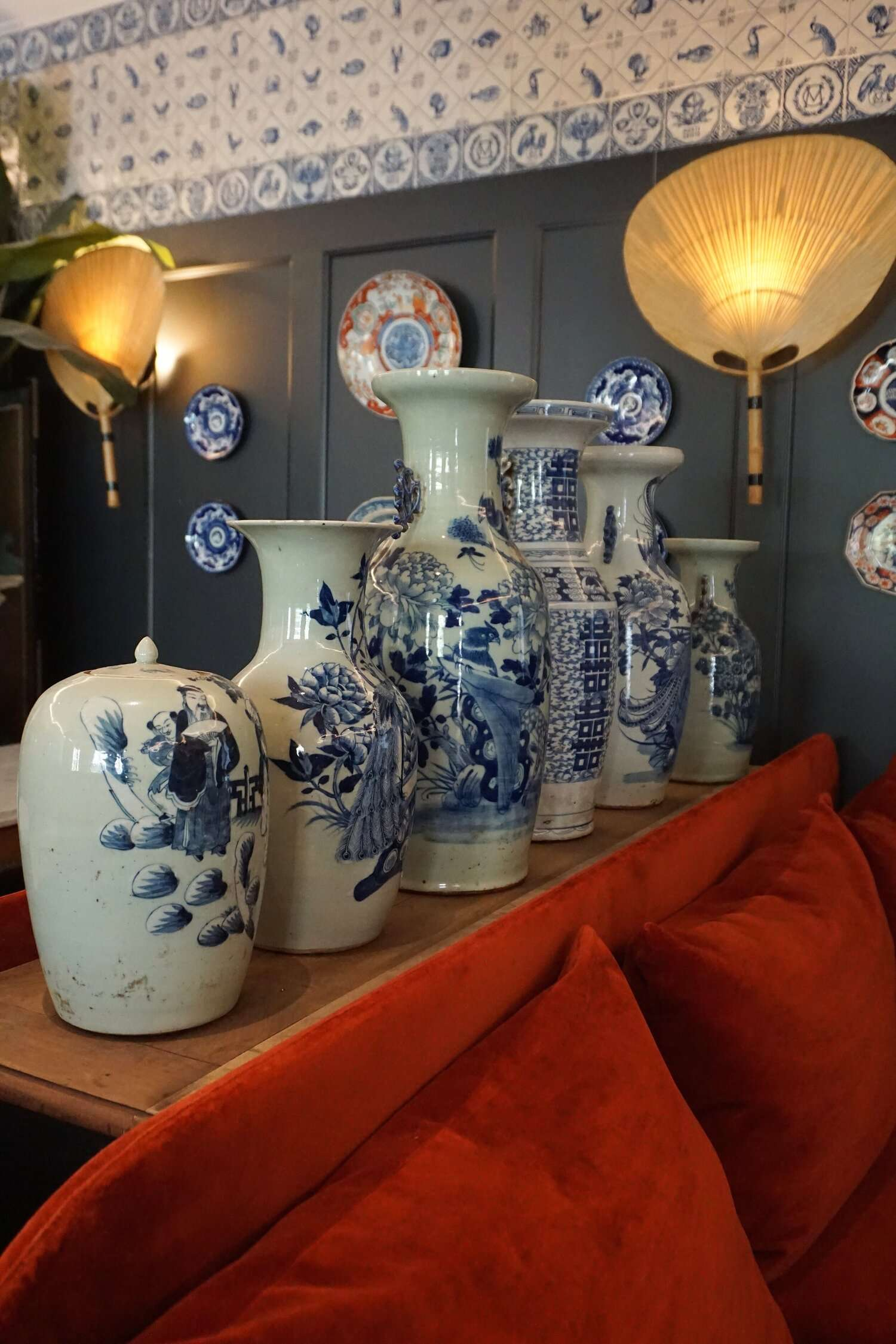 row of white and blue painted vases at Hotel Monte Cristo Paris