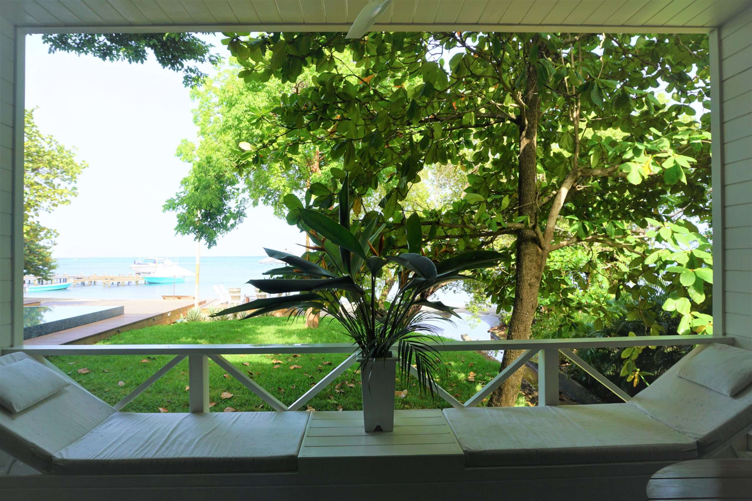 Ibagari Boutique Hotel bedroom view of gardens and sea