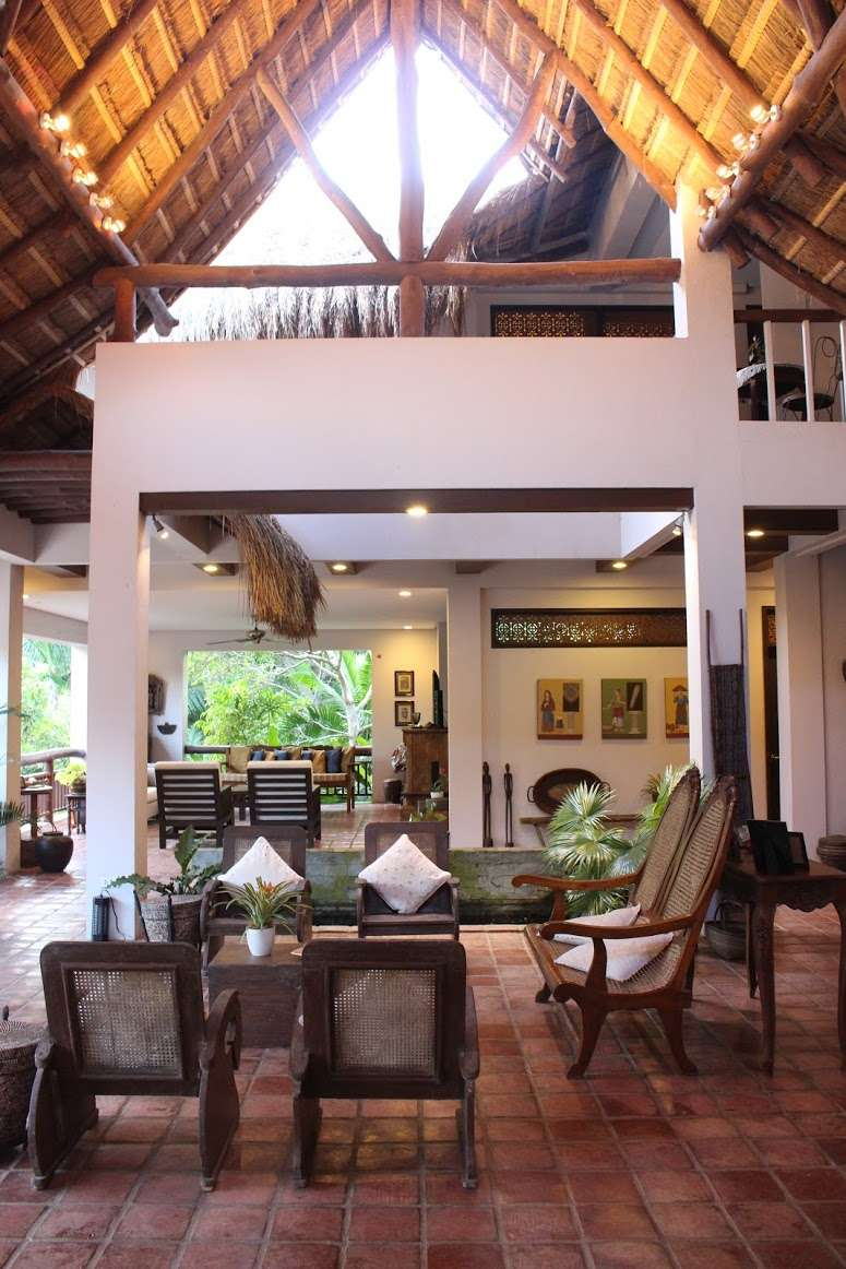 lounge area with high ceilings and open walls at La Casita de Baclayon in Bohol, Philippines