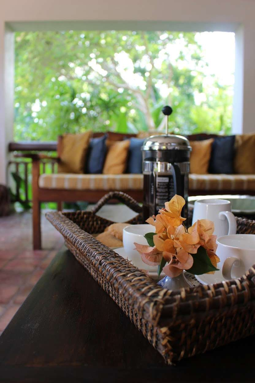 wicker tray with a French press coffee maker and tea cups at La Casita de Baclayon in Bohol, Philippines