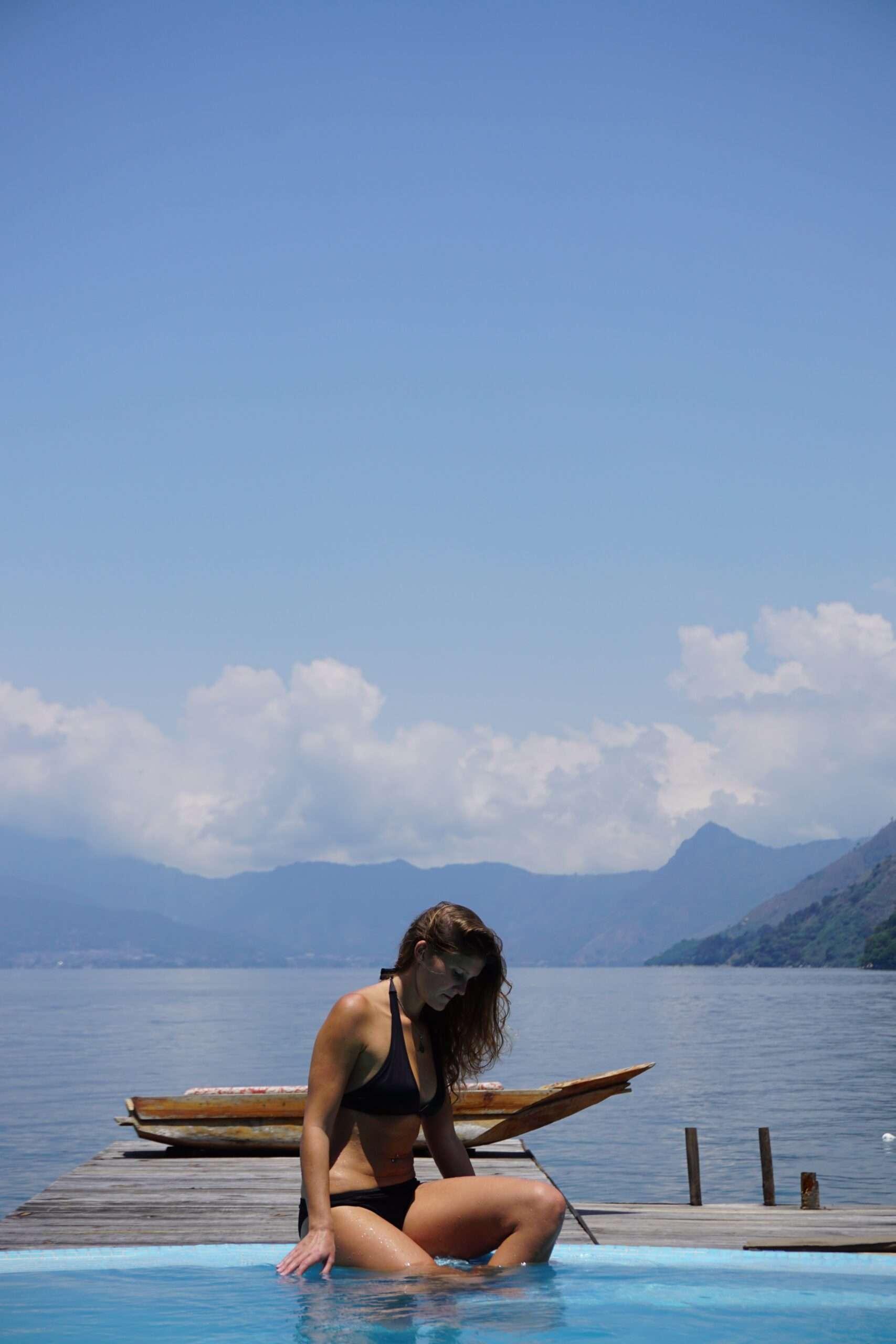 Woman relaxing on the dock at Laguna Lodge in Lake Atitlan in Guatemala