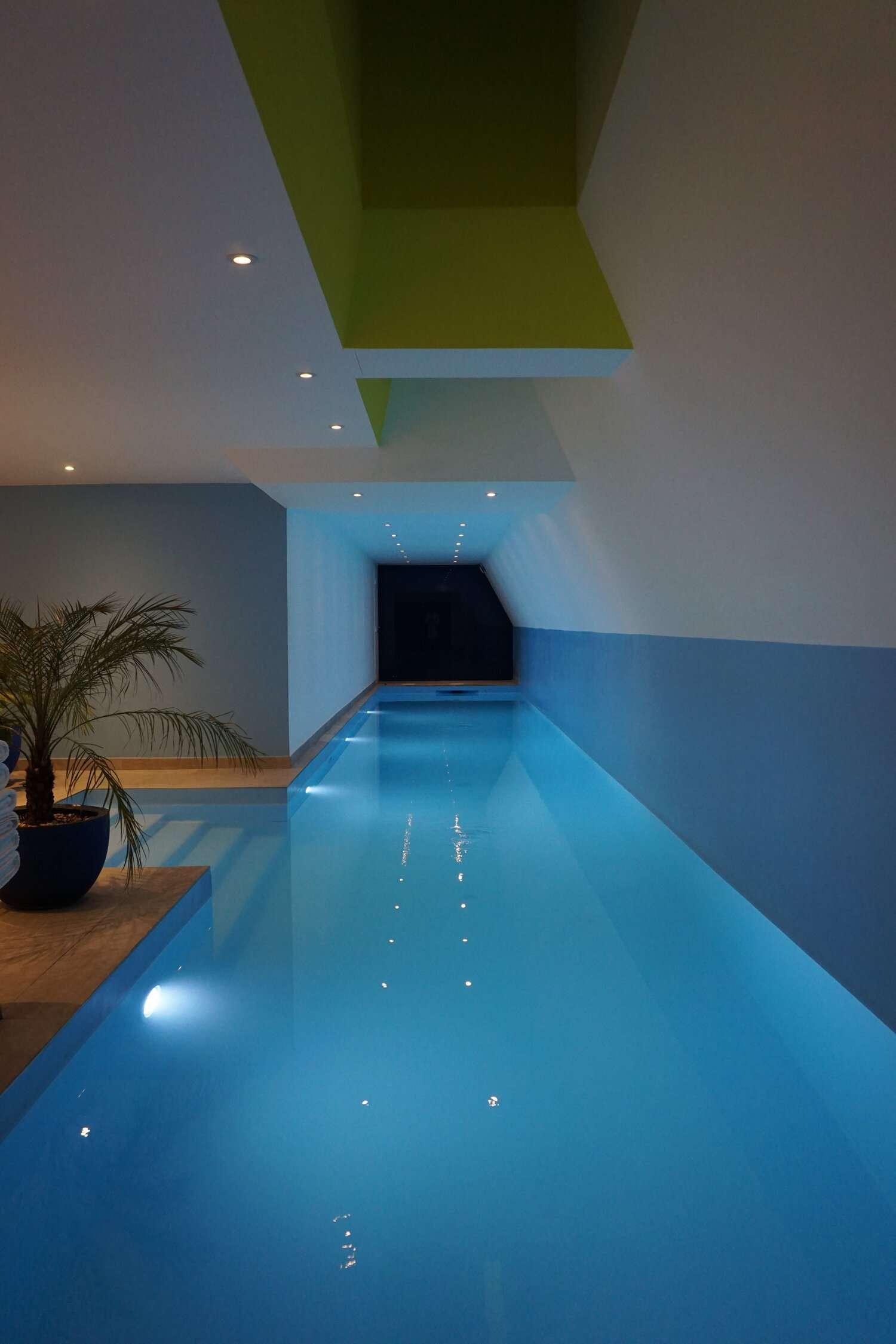 long indoor swimming pool at Le Hotel Parister in Paris