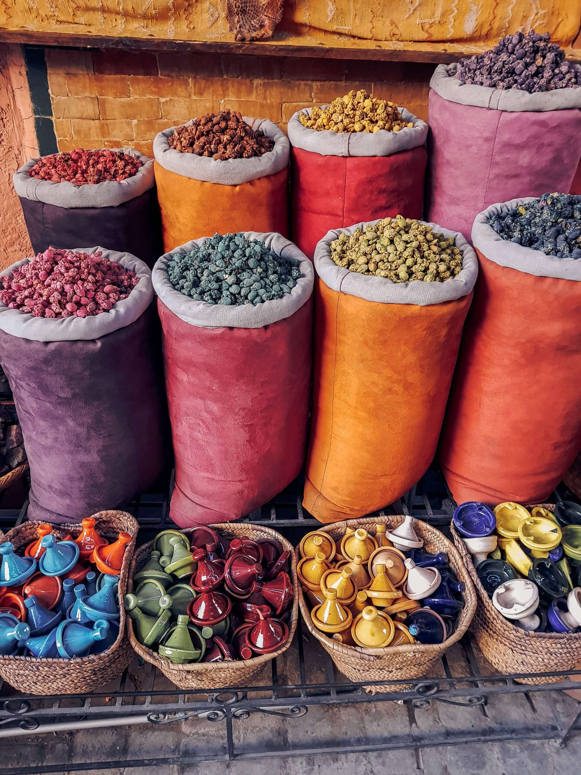 brightly coloured bags of coloured incense cones at a market in Marrakesh