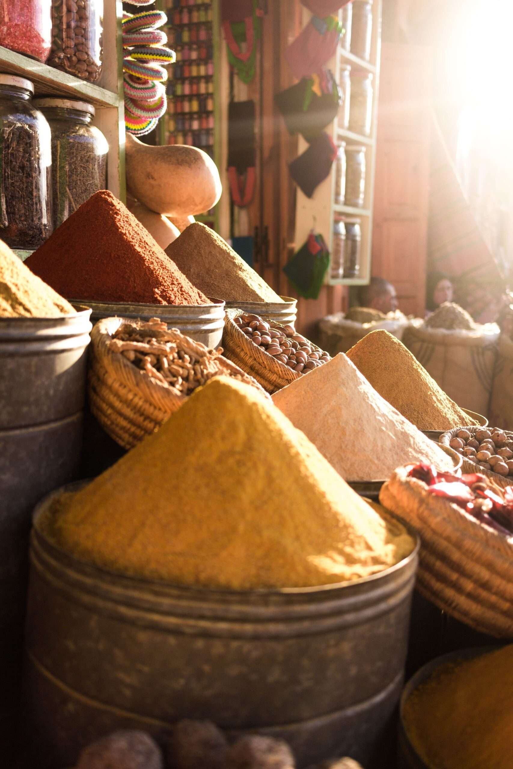 large piles of colourful spices at a market in Marrakesh