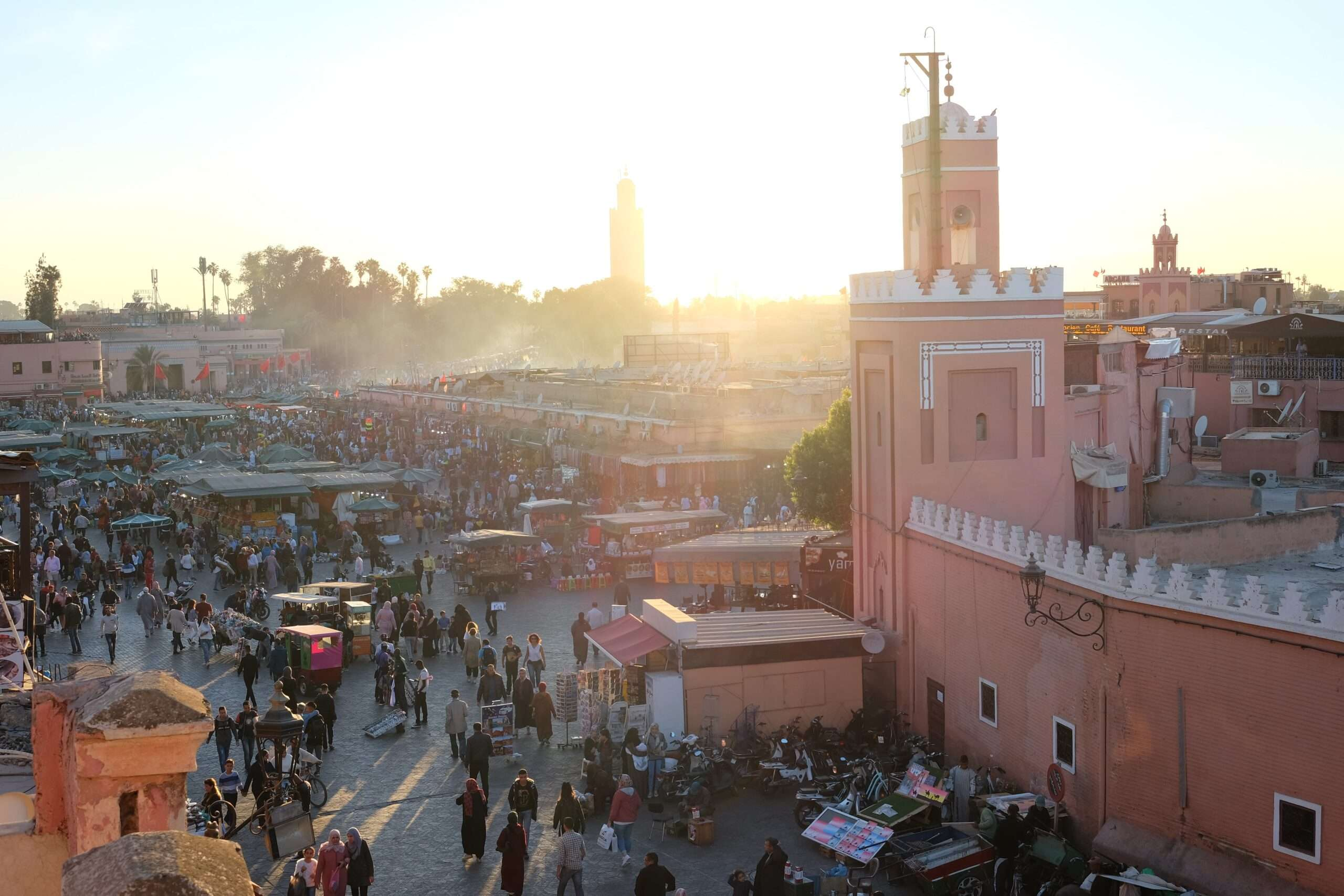 sun sets over busy markets in Marrakesh