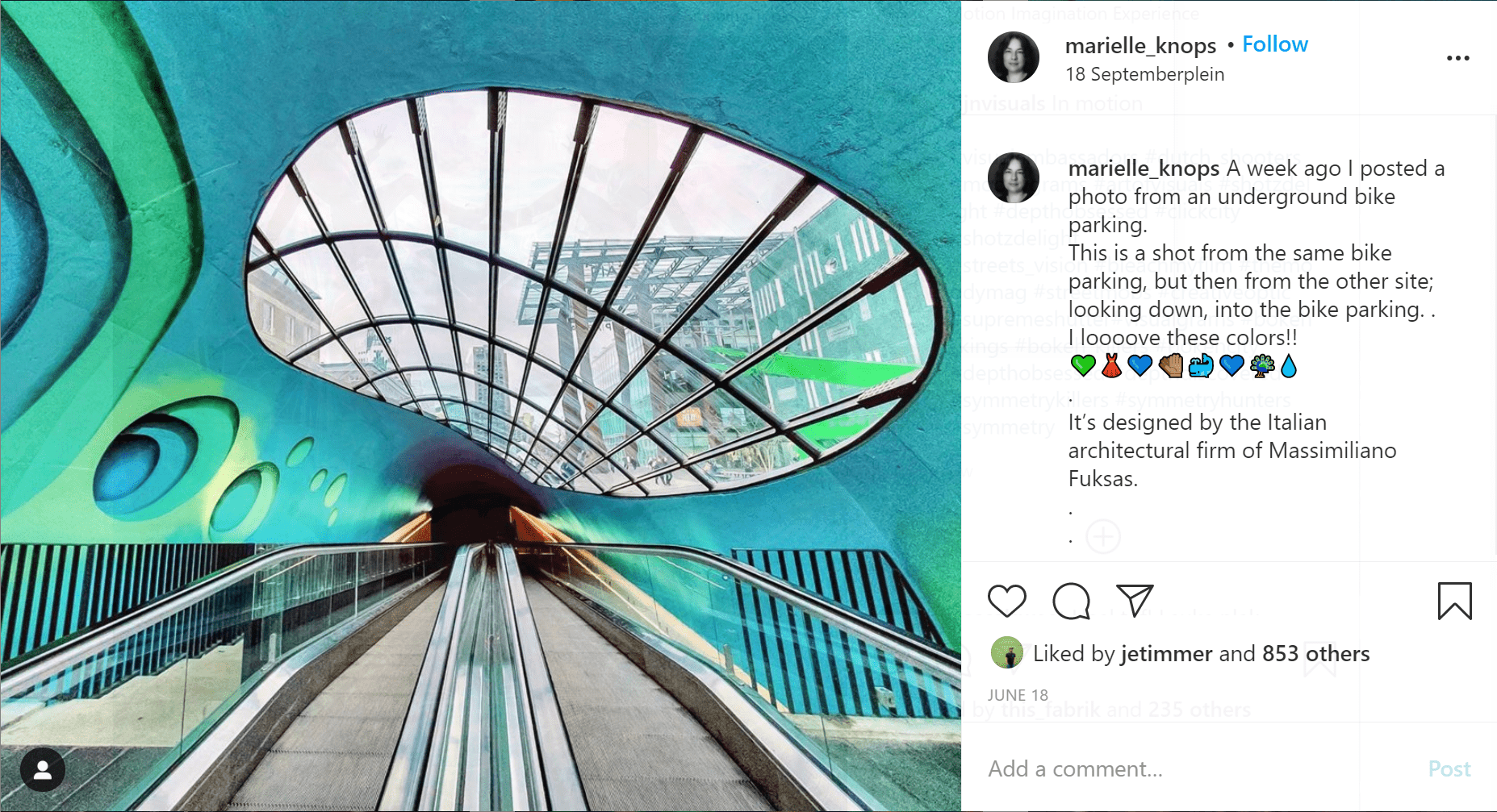 turquoise dome with circular sky windows above two escalators