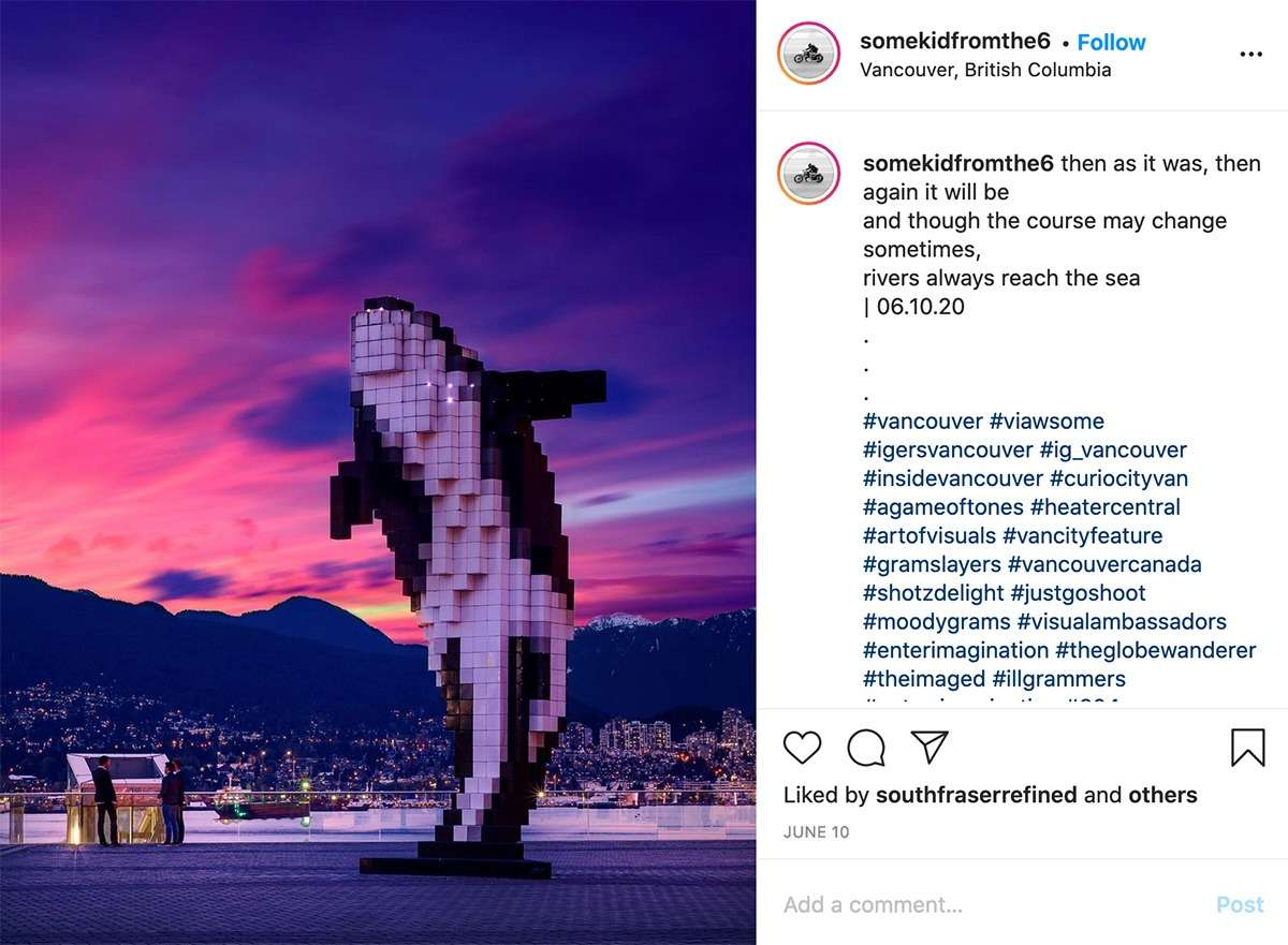 bright pink sunset sky behind the digital orca sculpture in Vancouver