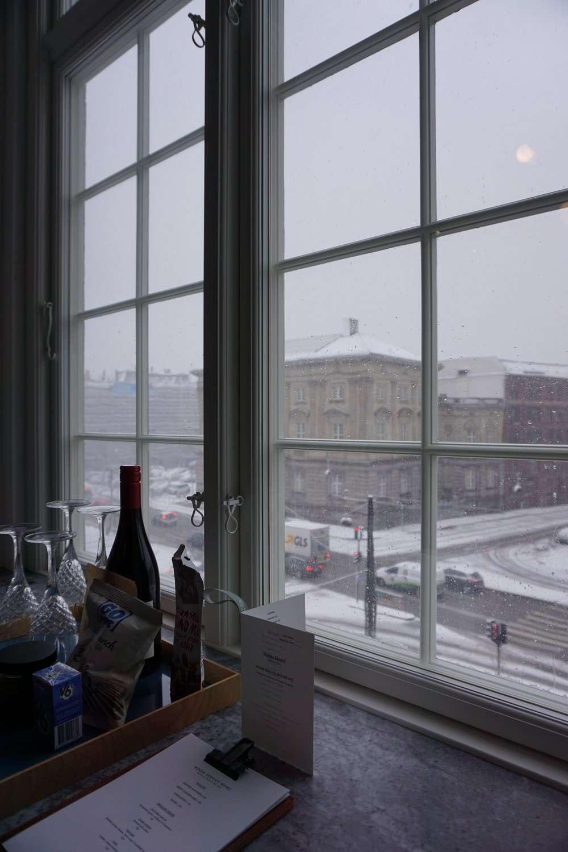 snowy streets seen from the bedroom window at Nobis Hotel Copenhagen
