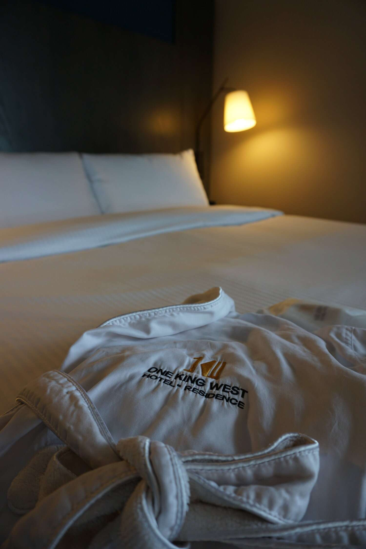 Hotel robe in bed at One King West hotel room