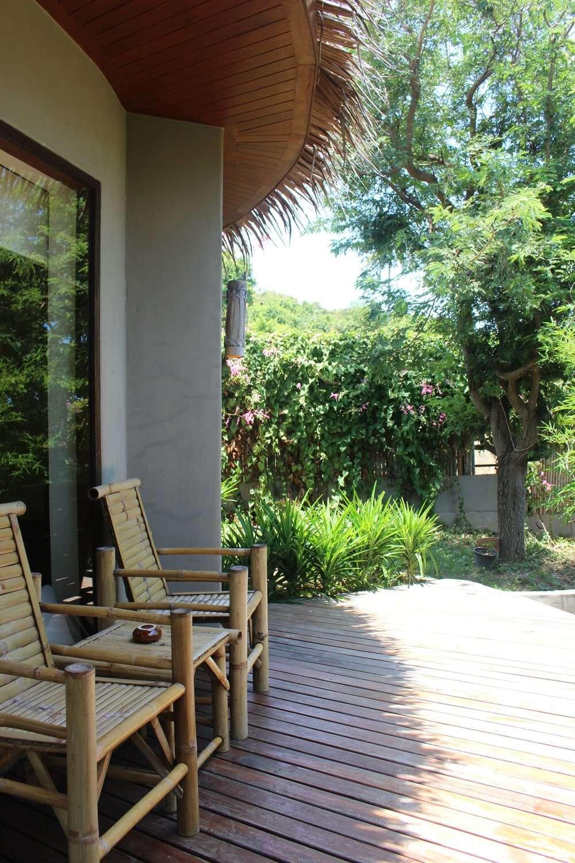 bamboo chairs at the front of the cabana at Sea Dance Resort Koh Samui