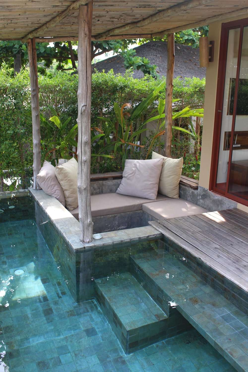 sofa with cushions beside a private pool at Sea Dance Resort Koh Samui