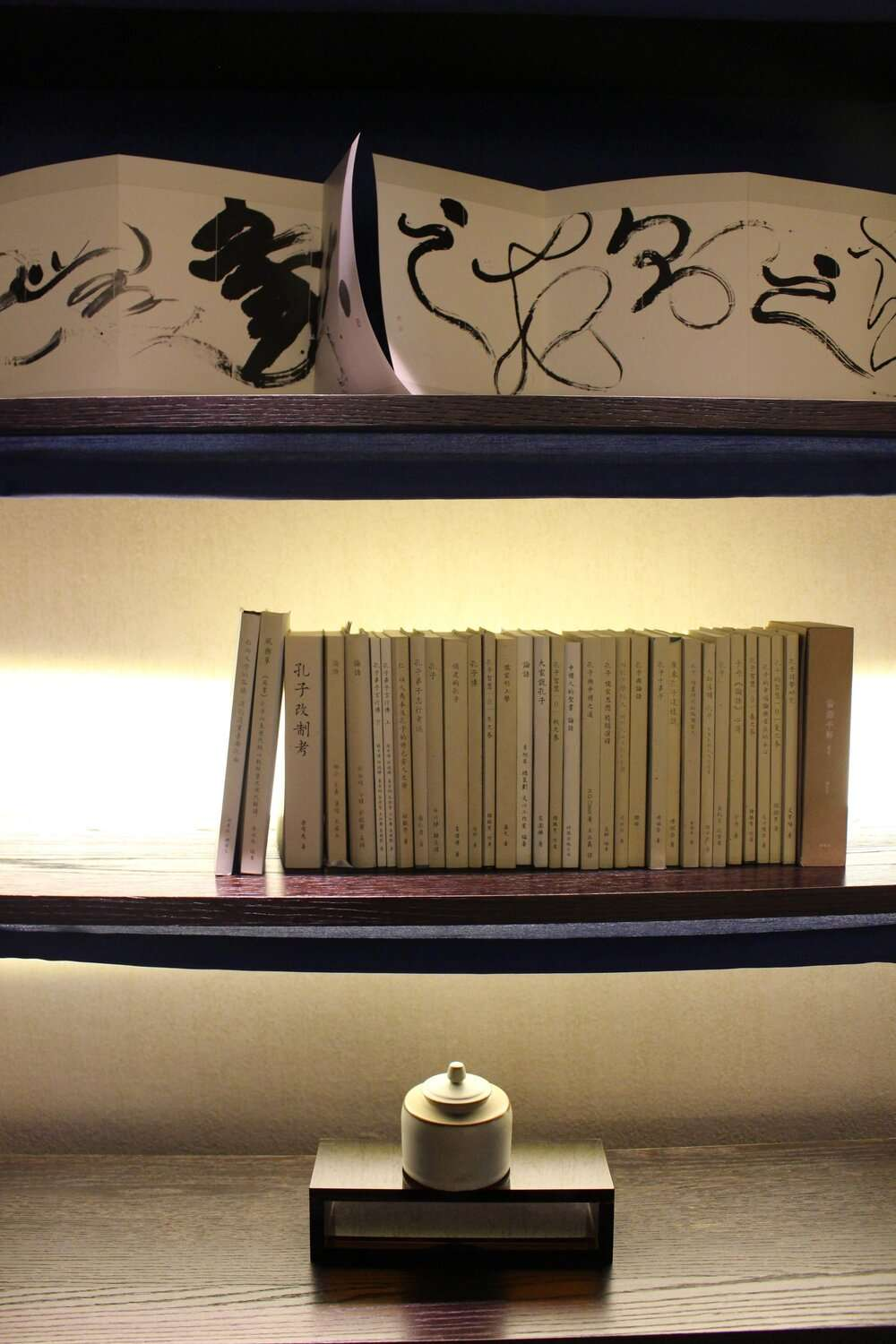 shelves with collectable books and calligraphy art work on display at Silks Place Tainan