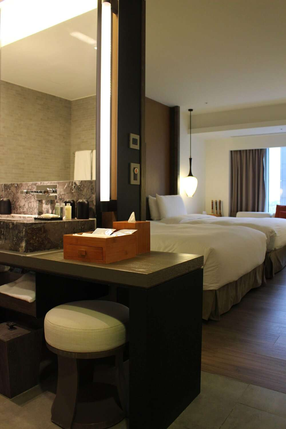bedroom and bathroom suite at Silks Place Tainan
